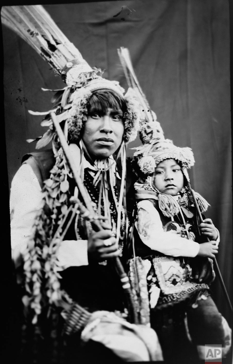 In this June 12, 2017 photo, Rudy Espiriya and his three-year-old son Dayiro Tahuara, pose for a portrait in the Sinakara Valley, in Peru's Cusco region, during the Qoyllur Rit'i festival, translated from the Quechua language as Snow Star. Rudy and Dayiro perform a dance called Paapuri Guayri as part of the Paucartambo nation. (AP Photo/Rodrigo Abd)