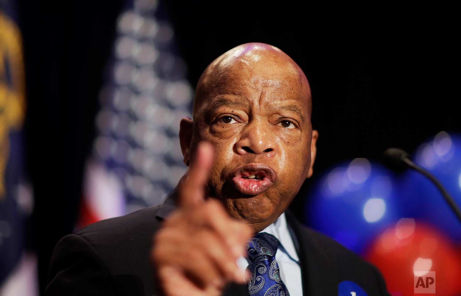 """In this Tuesday, June 20, 2017 photo, Rep. John Lewis, D-Ga., speaks at an election night party for Democratic candidate for 6th congressional district Jon Ossoff in Atlanta. Commissioners in a suburban Atlanta county have voted to publicly reprimand a colleague, Commissioner Tommy Hunter, for calling civil rights leader and U.S. Rep. John Lewis a """"racist pig"""" on Facebook. News outlets reported the decision on Tuesday, June 20, 2017, following the recommendation of Gwinnett County's ethics board, which voted earlier in June to sustain the ethics complaint against the Commissioner. (AP Photo/David Goldman)"""