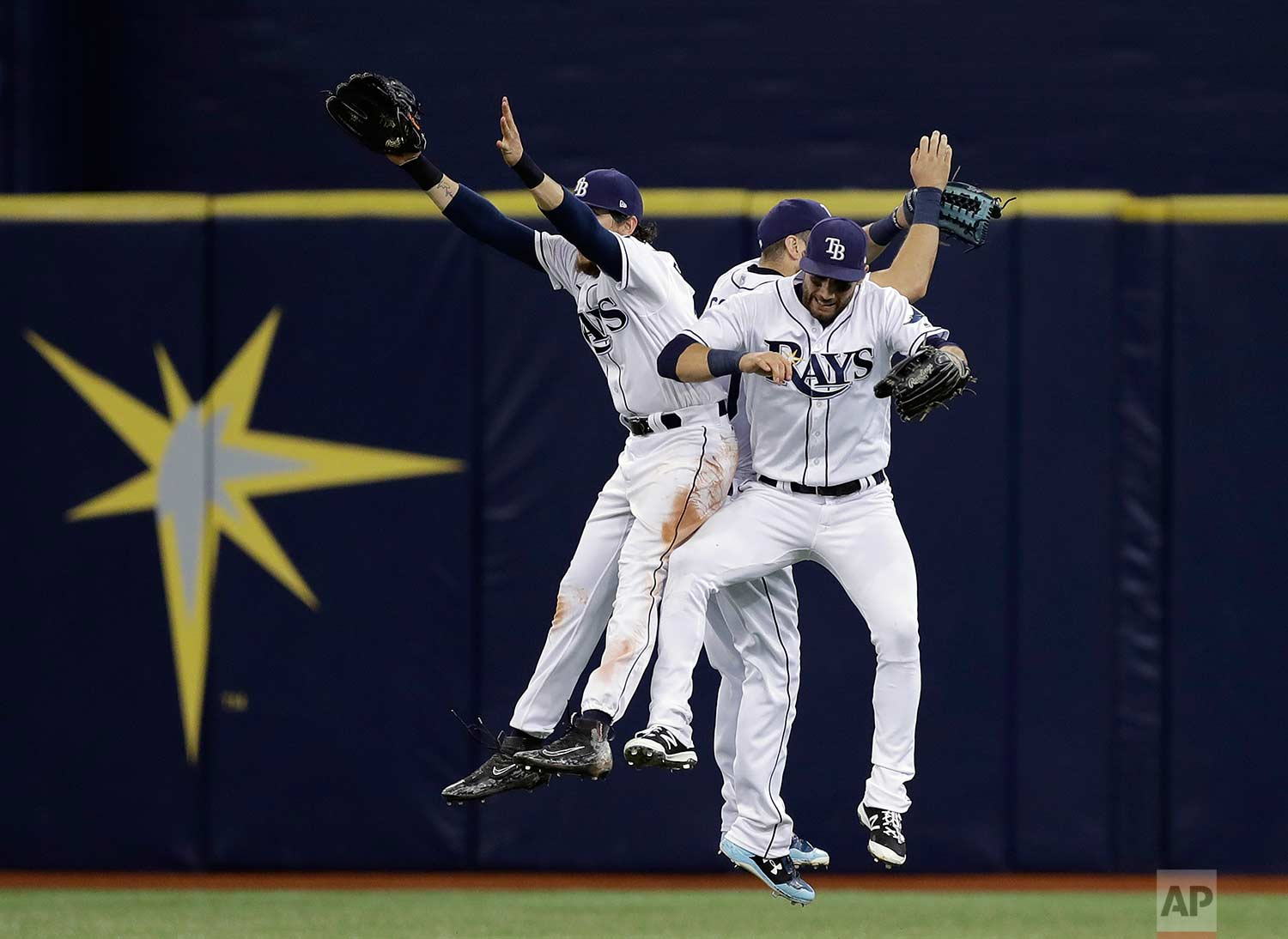Tampa Bay Rays center fielder Colby Rasmus, right fielder Steven Souza Jr., and center fielder Kevin Kiermaier, from left, celebrate the team's 3-1 win over the Chicago White Sox in a baseball game Wednesday, June 7, 2017, in St. Petersburg, Fla. (AP Photo/Chris O'Meara)