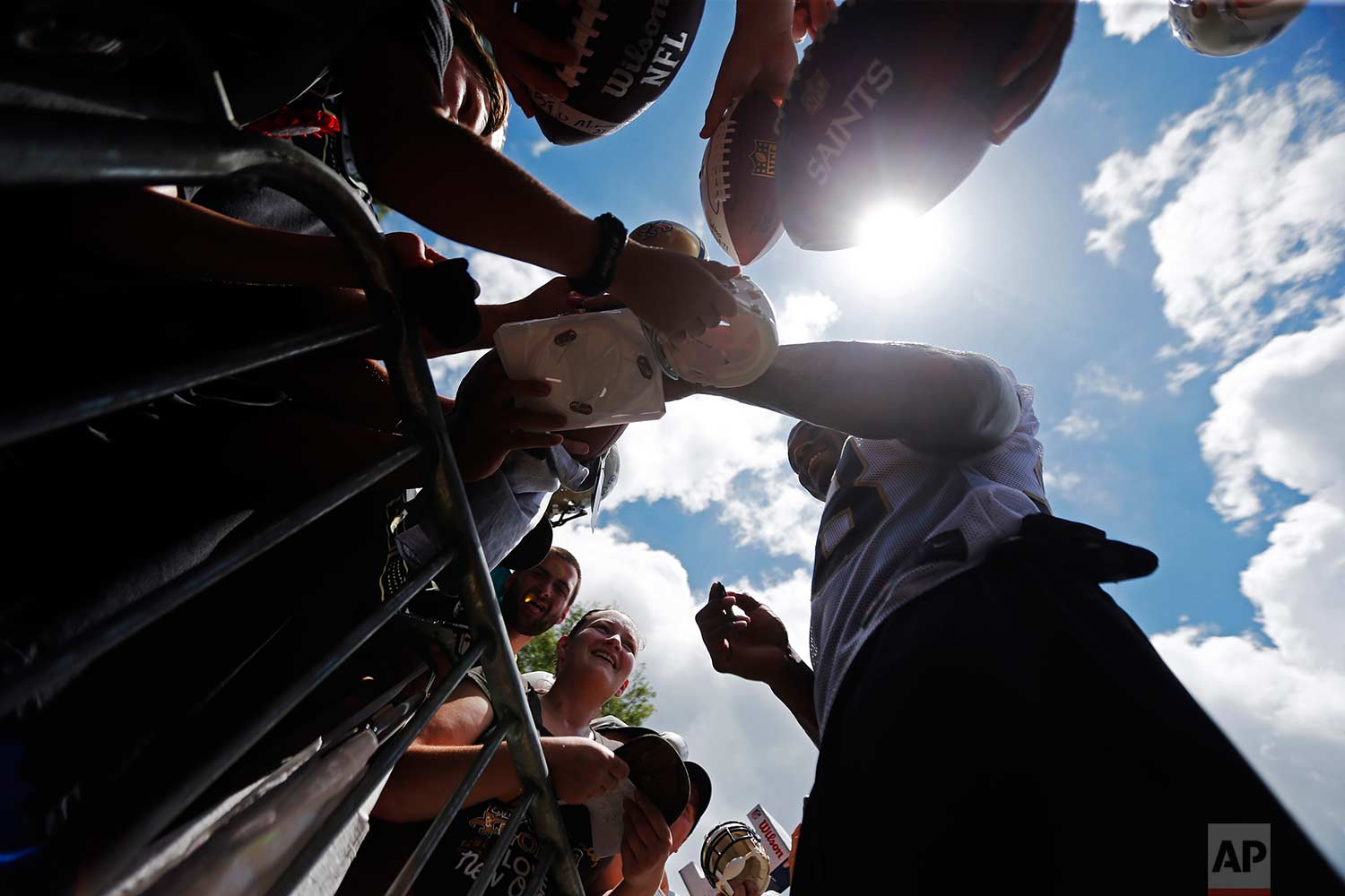 New Orleans Saints running back Adrian Peterson (28) signs autographs at the conclusion of NFL football practice in Metairie, La., Thursday, June 15, 2017. (AP Photo/Gerald Herbert)