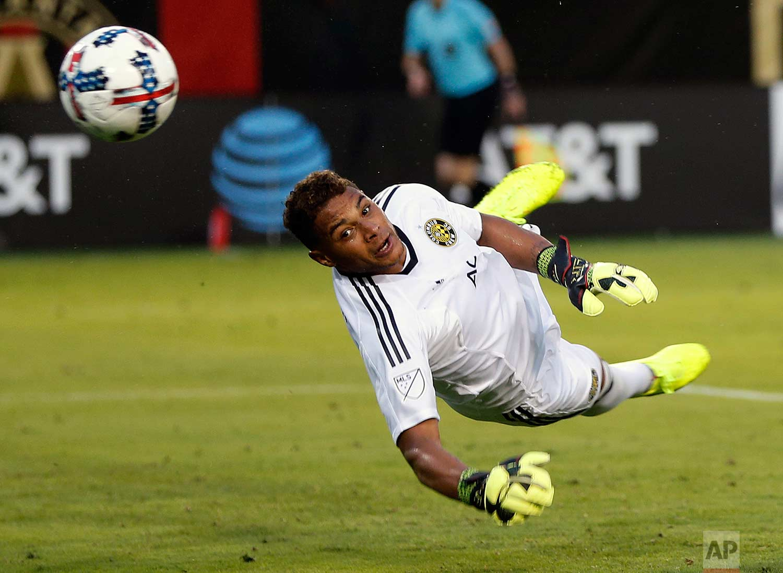 Columbus Crew goalkeeper Zack Steffen (23) blocks a shot in the second half of an MLS soccer match against Atlanta United, Saturday, June 17, 2017, in Atlanta. (AP Photo/John Bazemore)