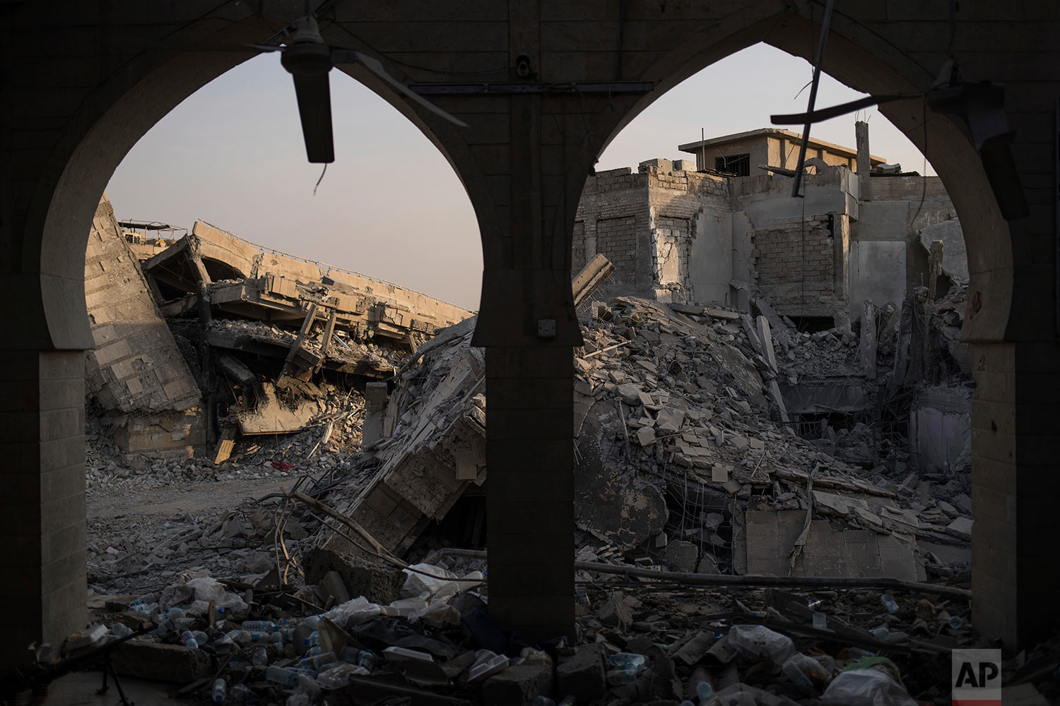 In this July 9, 2017 photo, destroyed buildings sit in the Old City of Mosul, Iraq. (AP Photo/Felipe Dana)