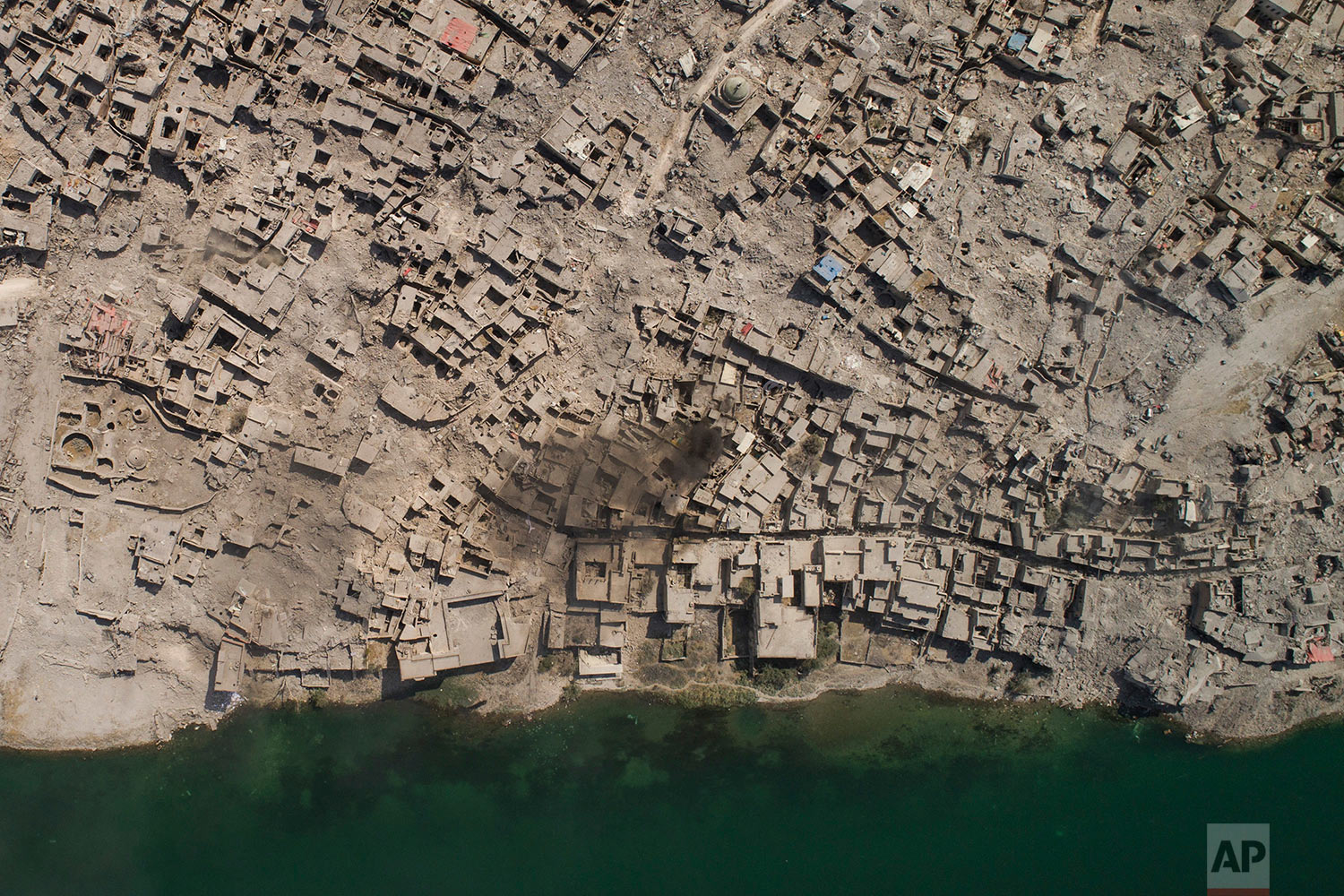 In this July 10, 2017 photo, aerial view of the Tigris river and the Old City of Mosul, Iraq. (AP Photo/Felipe Dana)