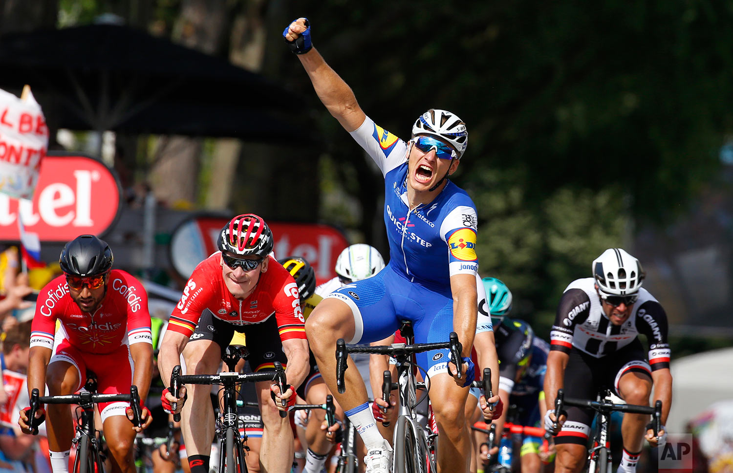 Germany's sprinter Marcel Kittel celebrates next to Germany's Andre Greipel, center center left, as he crosses the finish line to win the sixth stage of the Tour de France cycling race over 216 kilometers (134 miles) with start in Vesoul and finish in Troyes, France, Thursday, July 6, 2017. (AP Photo/Peter Dejong)