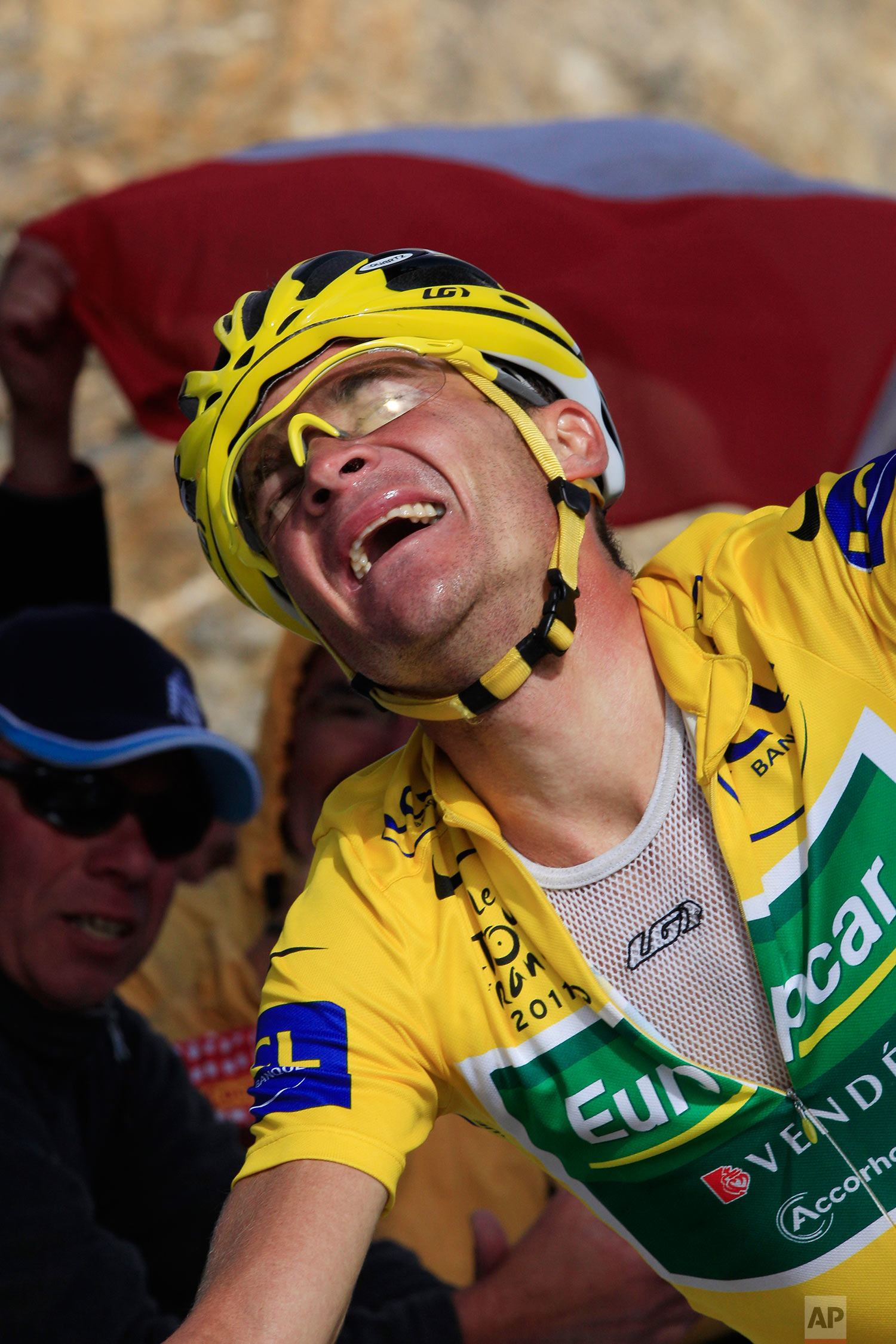 Thomas Voeckler of France, who retains the overall leader's yellow jersey, rejoices as he crosses the finish line on Galibier pass to win the 18th stage of the Tour de France cycling race over 200.5 kilometers (124.6 miles) starting in Pinerolo, Italy, and finishing on Galibier pass, Alps region, France, Thursday July 21, 2011. (AP Photo/Laurent Rebours)