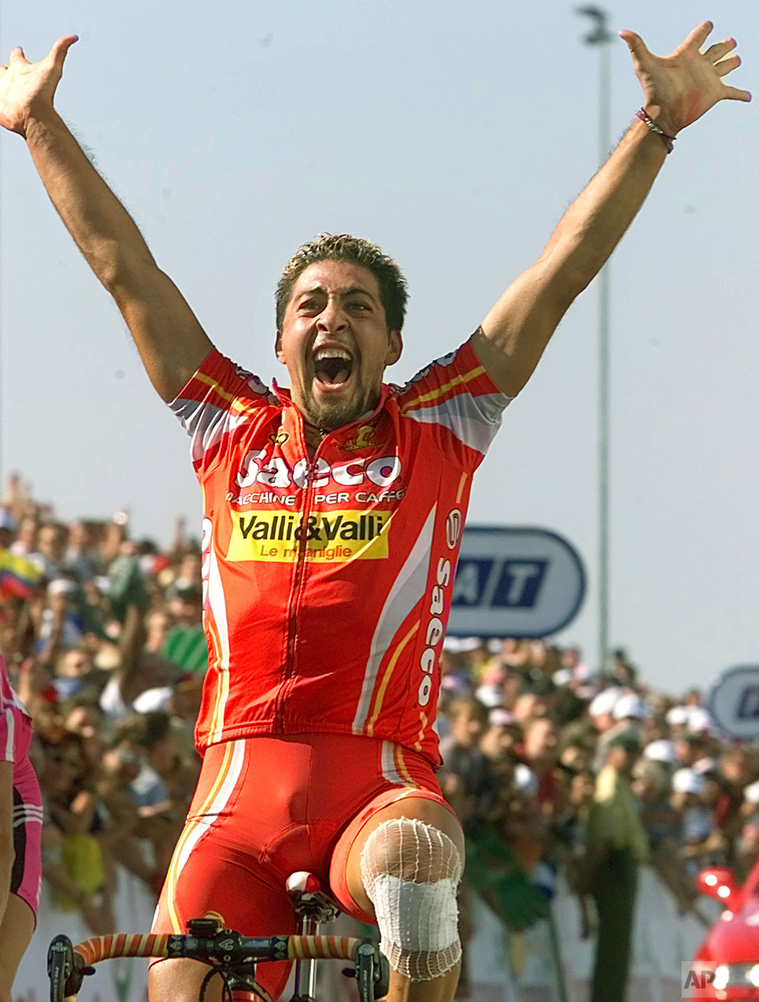 Salvatore Commesso of Italy reacts as he crosses the finish line to win the 18th stage of the Tour de France cycling race between Lausanne, Switzerland, and Freiburg, Germany, Thursday, July 20, 2000. (AP Photo/Laurent Rebours)