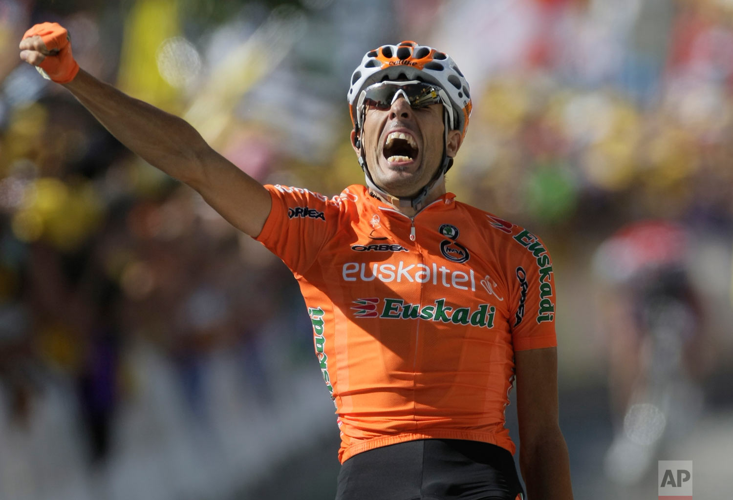 Mikel Astarloza of Spain reacts as he crosses the finish line to win the 16th stage of the Tour de France cycling race over 159 kilometers (98.8 miles) with start in Martigny, Switzerland and finish in Bourg-Saint-Maurice, Alps region, France, Tuesday July 21, 2009. (AP Photo/Laurent Rebours)