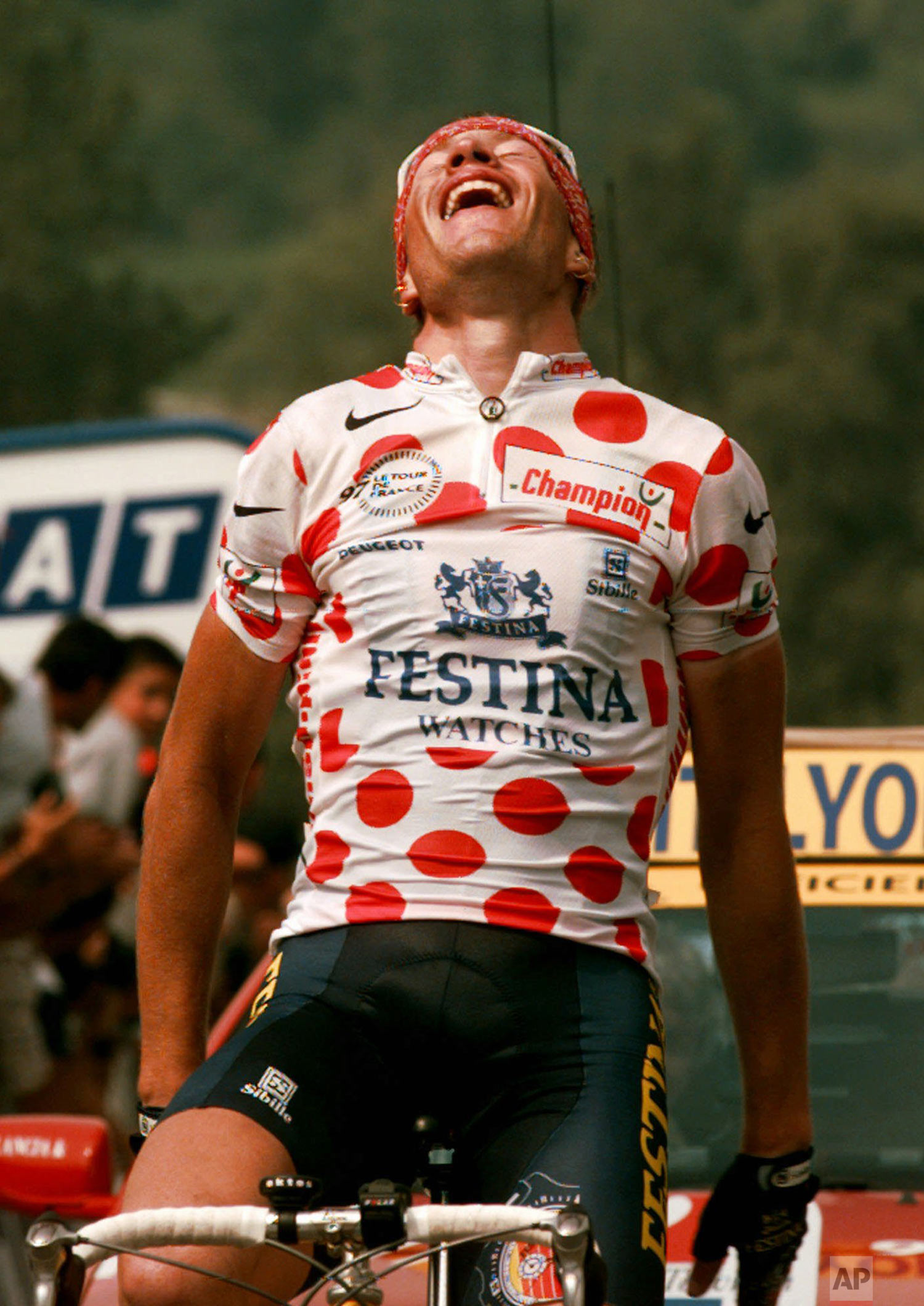 Laurent Brochard of France reacts as he crosses the finish line to win the 9th stage of the Tour de France cycling race between Pau and Loudenvielle in the Pyrenees mountains Monday July 14, 1997. (AP Photo/Laurent Rebours)