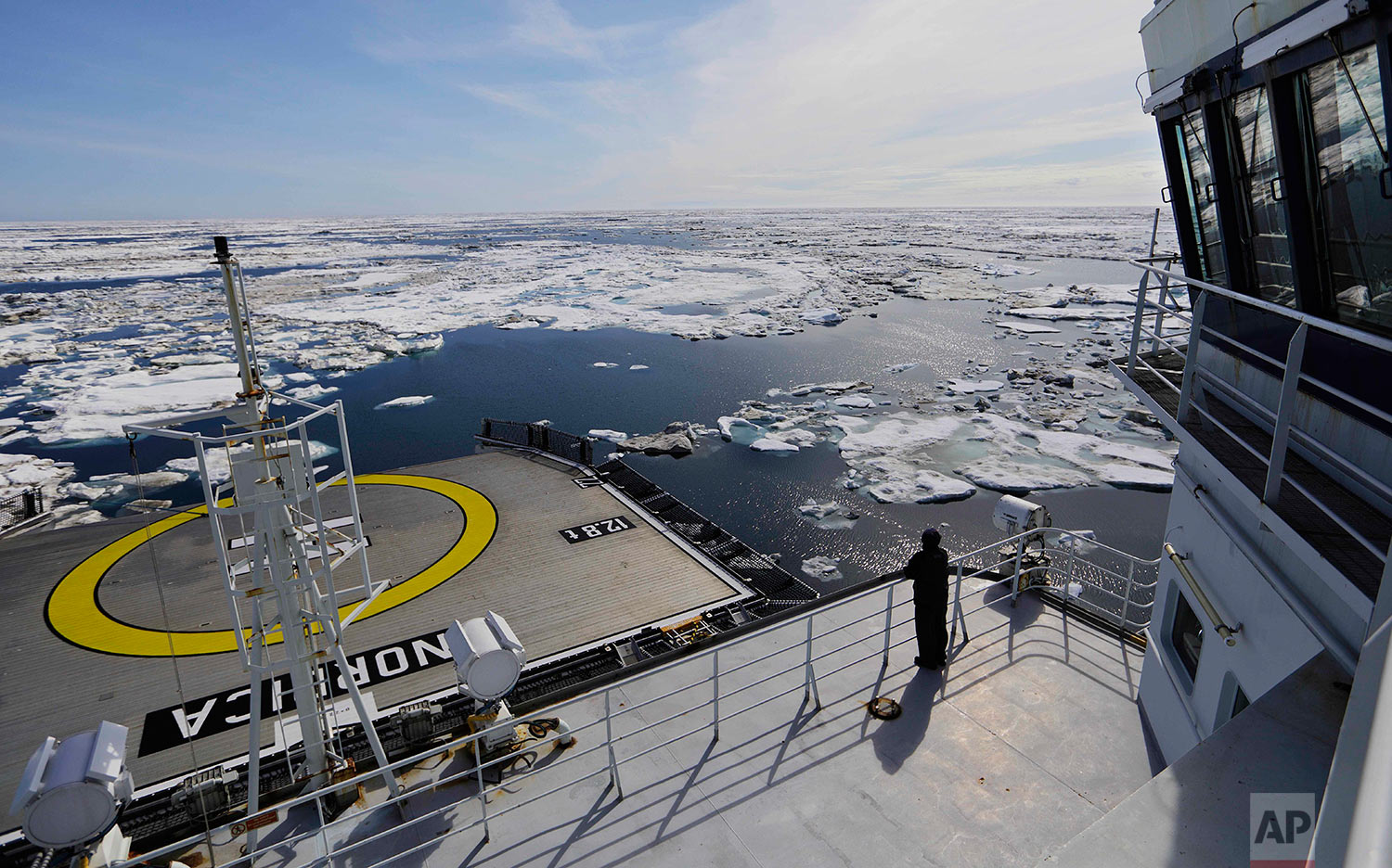 The Finnish icebreaker MSV Nordica sails through ice floating on the Beaufort Sea off the coast of Alaska, Sunday, July 16, 2017, while traversing the Arctic's Northwest Passage, where global warming is melting sea ice and glaciers at an historic rate, altering and opening up the Arctic as never before. (AP Photo/David Goldman)