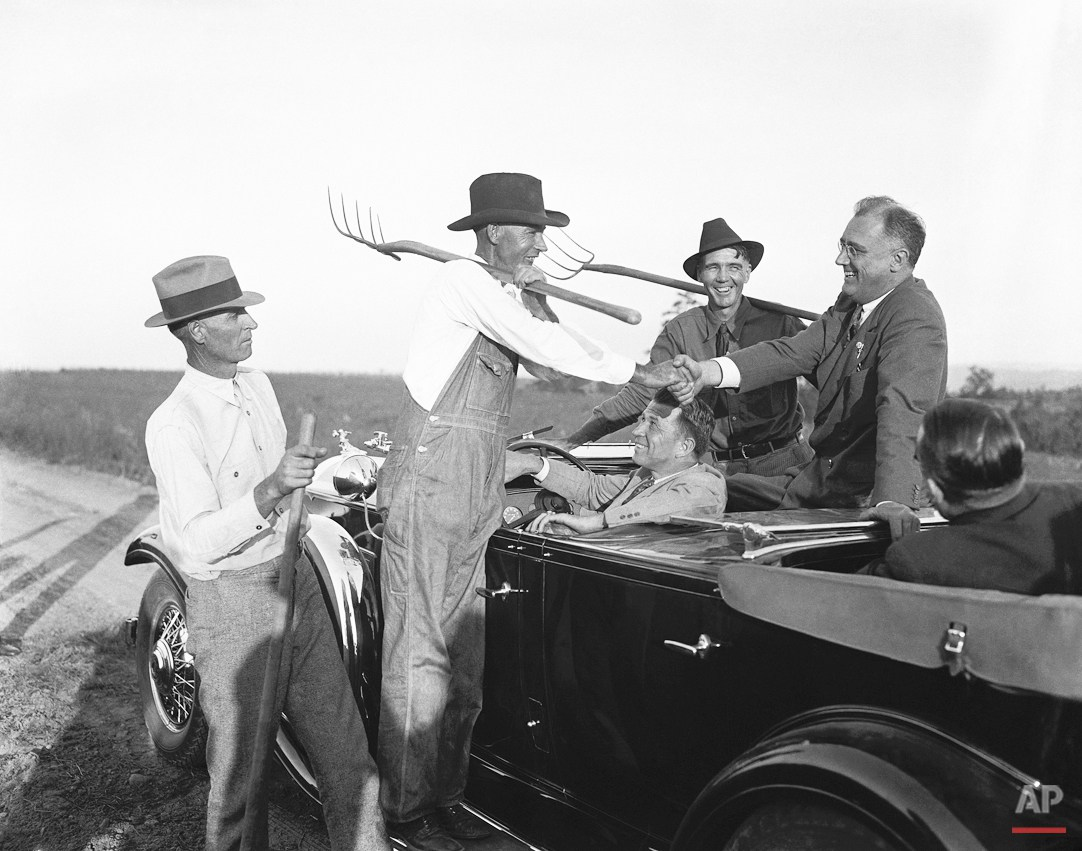 Democratic presidential candidate Franklin D. Roosevelt is greeted by Georgia farmers while en route to Warm Springs, Ga., Oct. 24, 1932.  (AP Photo)