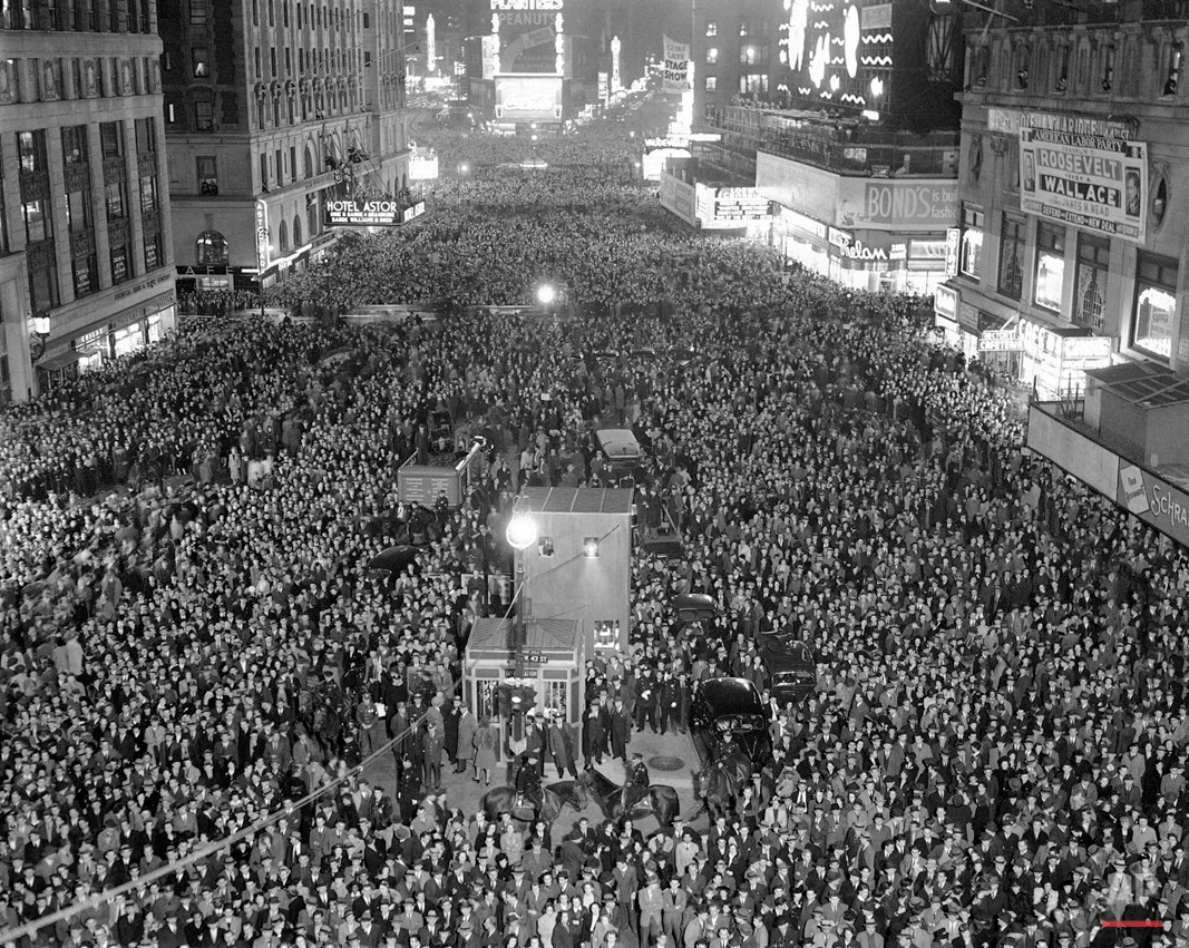 Some of the thousands of persons who packed Times Square in New York, Nov. 5, 1940, in the excitement of the presidential election. Observers believed it was the largest crowd ever to gather in the square. Election results were flashed from the tower of the Times building. Bulletins, as received were also displayed on the electric sign around the building and on a bulletin board at the north end of the building. (AP Photo)