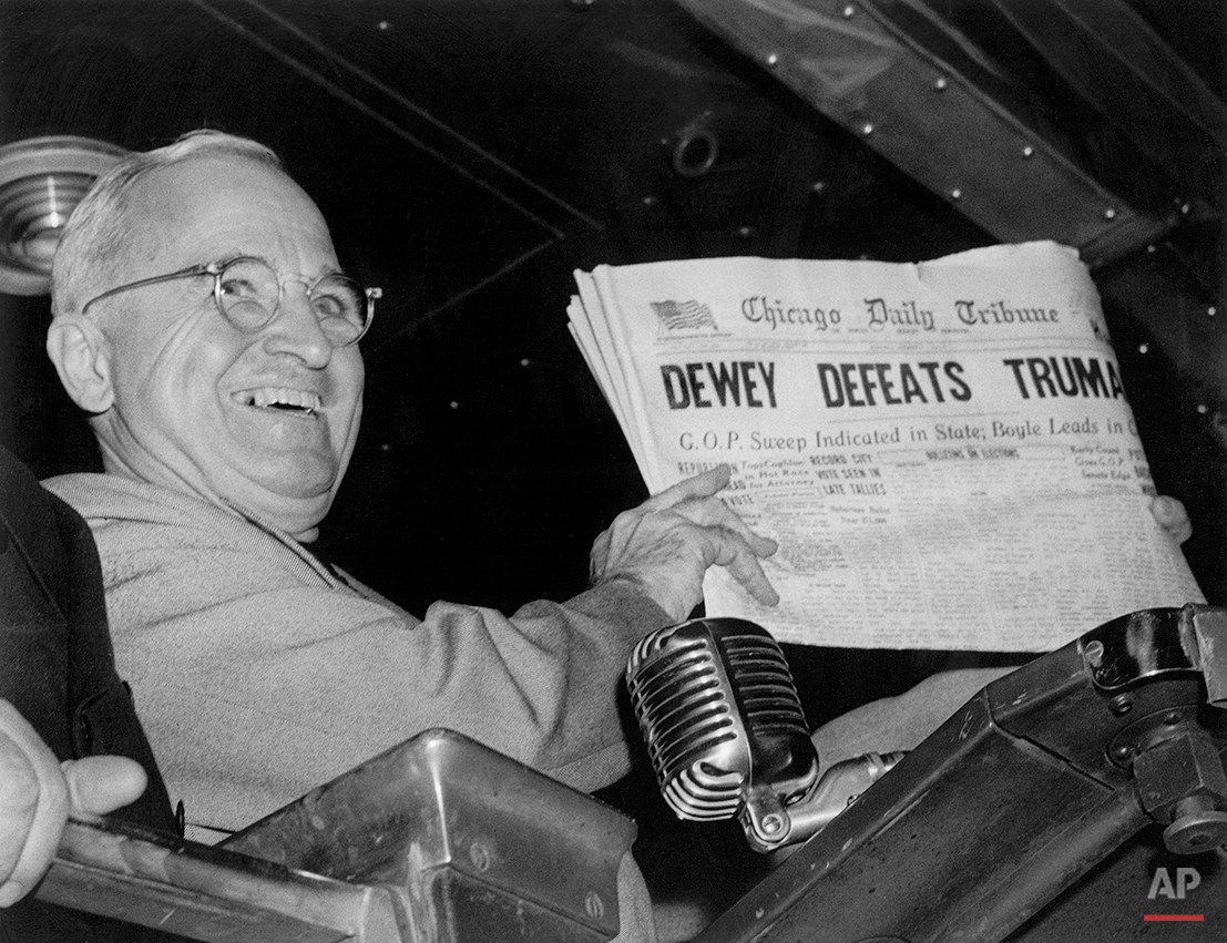 "In this Nov. 4, 1948, photo, President Harry S. Truman holds up an election day edition of the Chicago Daily Tribune, which, based on early results, mistakenly announced ""Dewey Defeats Truman."" ""If Congress does something, then I can't run against a do-nothing Congress,"" President Barack Obama said Oct. 6, 2011, at a White House news conference. ""If Congress does nothing, then it's not a matter of me running against them. I think the American people will run them out of town."" Obama's message is straight out of the playbook of Truman, who overcame a midterm drubbing by Republicans and assailed a ""do-nothing"" Congress from the back of a campaign train to win another term in 1948. The comeback was epitomized by a jubilant Truman hoisting a copy of the paper. (AP Photo/Byron Rollins)"