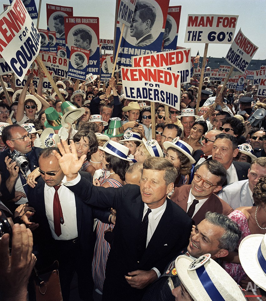 Sen. John F. Kennedy makes his way through a crowd of supporters and journalists as he arrives in Los Angeles, July 9, 1960 for the Democratic National Convention. (AP Photo)