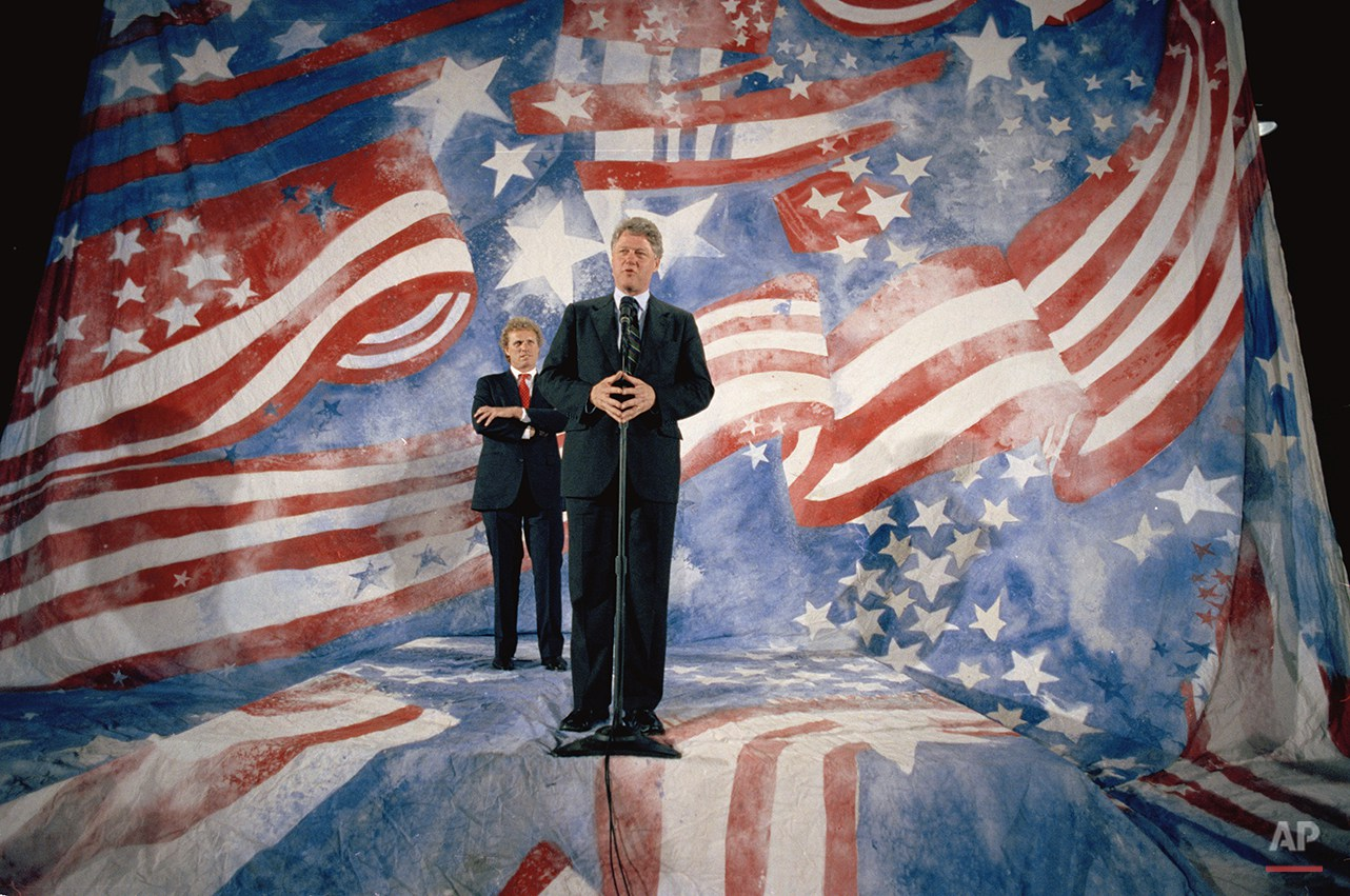 Democratic presidential hopeful Bill Clinton addresses the media as U.S. Rep. Joseph Kennedy, D-Mass., looks on at a Boston campaign stop the evening of April 28, 1992.  (AP Photo/Stephan Savoia)