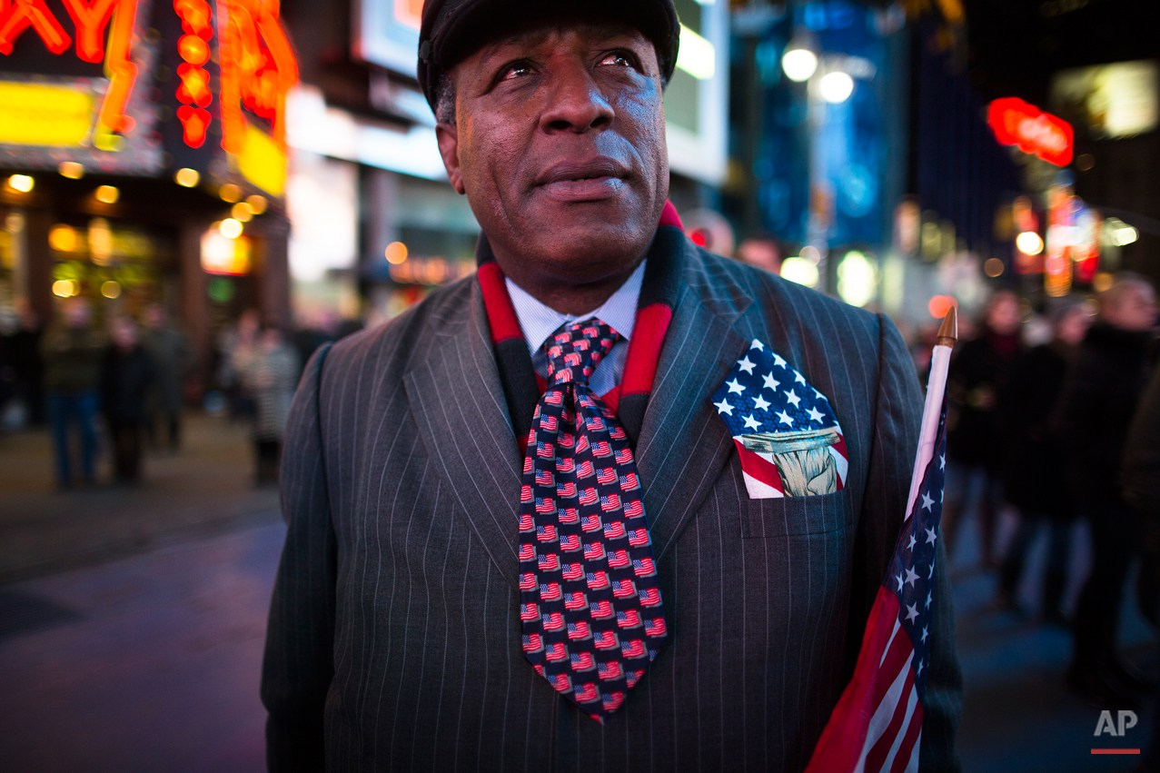 Howard Nizebeth, 48, watches election results in Times Square, Tuesday, Nov. 6, 2012, in New York. After a year of campaigning, polls have begun to close after Americans across the United States headed to the polls to decide the winner of the tight presidential race between President Barack Obama and former Massachusetts Governor Mitt Romney. (AP Photo/ John Minchillo)