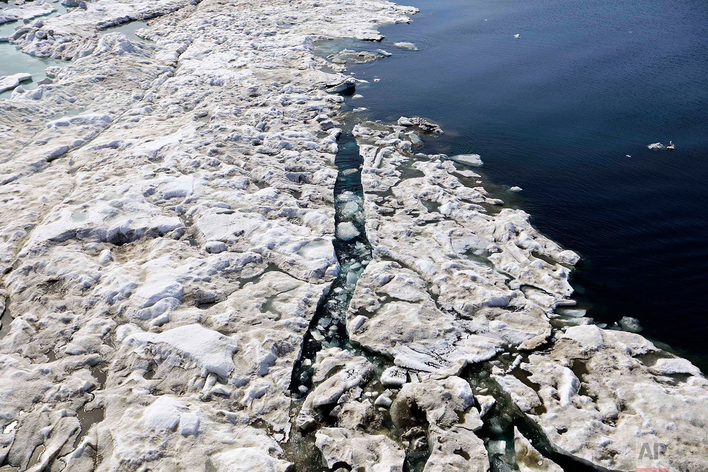 Sea ice breaks up as the Finnish icebreaker MSV Nordica sails through the Beaufort Sea off the coast of Alaska while traversing the Arctic's Northwest Passage, Sunday, July 16, 2017. (AP Photo/David Goldman)
