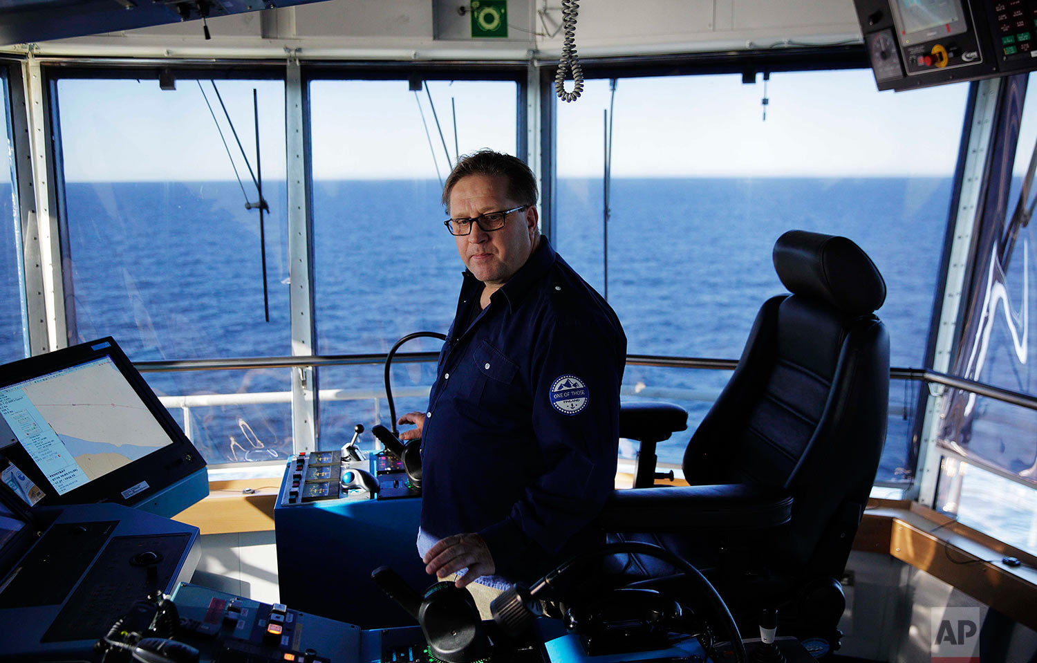 Master Mariner Jyri Viljanen, captain of the Finnish icebreaker MSV Nordica demonstrates the ship's maneuverability while sailing the Dolphin and Union Strait off the coast of Canada through the Arctic's Northwest Passage, Wednesday, July 19, 2017. According to Viljanen, only lots of supervised practice can adequately prepare a person for the challenges of steering the 13,000 ton ship. (AP Photo/David Goldman)
