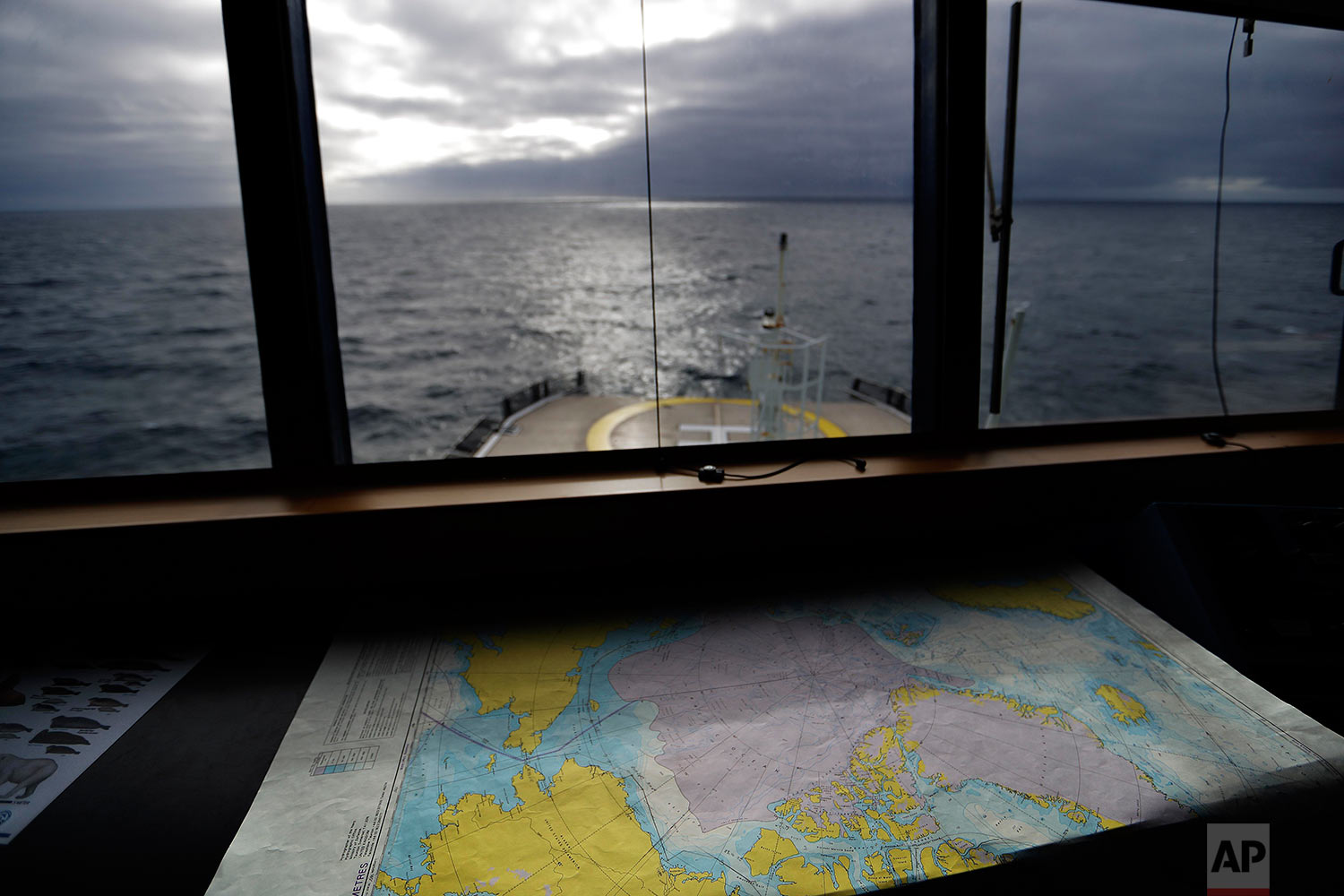 A map of the Arctic Ocean overlooks the bow of the Finnish icebreaker MSV Nordica as it sails in the North Pacific Ocean toward the Bering Sea on Sunday, July 9, 2017. While icebreakers are equipped with sensitive radar systems, ultimately it's up to the ability and experience of the person at the helm to ensure the ship only breaks ice when it's unavoidable. (AP Photo/David Goldman)