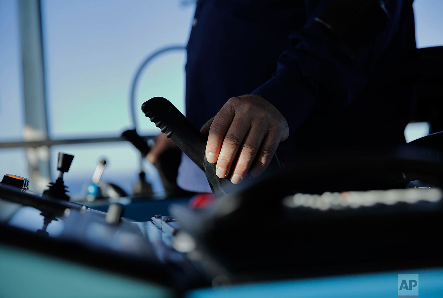 Master Mariner Jyri Viljanen, captain of the Finnish icebreaker MSV Nordica. pushes the thruster while demonstrating the ship's maneuverability while sailing the Dolphin and Union Strait off the coast of Canada through the Arctic's Northwest Passage, Wednesday, July 19, 2017. Icebreakers with azimuth thrusters, such as the Nordica, are extremely maneuverable and can change direction very quickly, allowing the ship to avoid many unnecessary encounters with ice that would otherwise slow it down. (AP Photo/David Goldman)