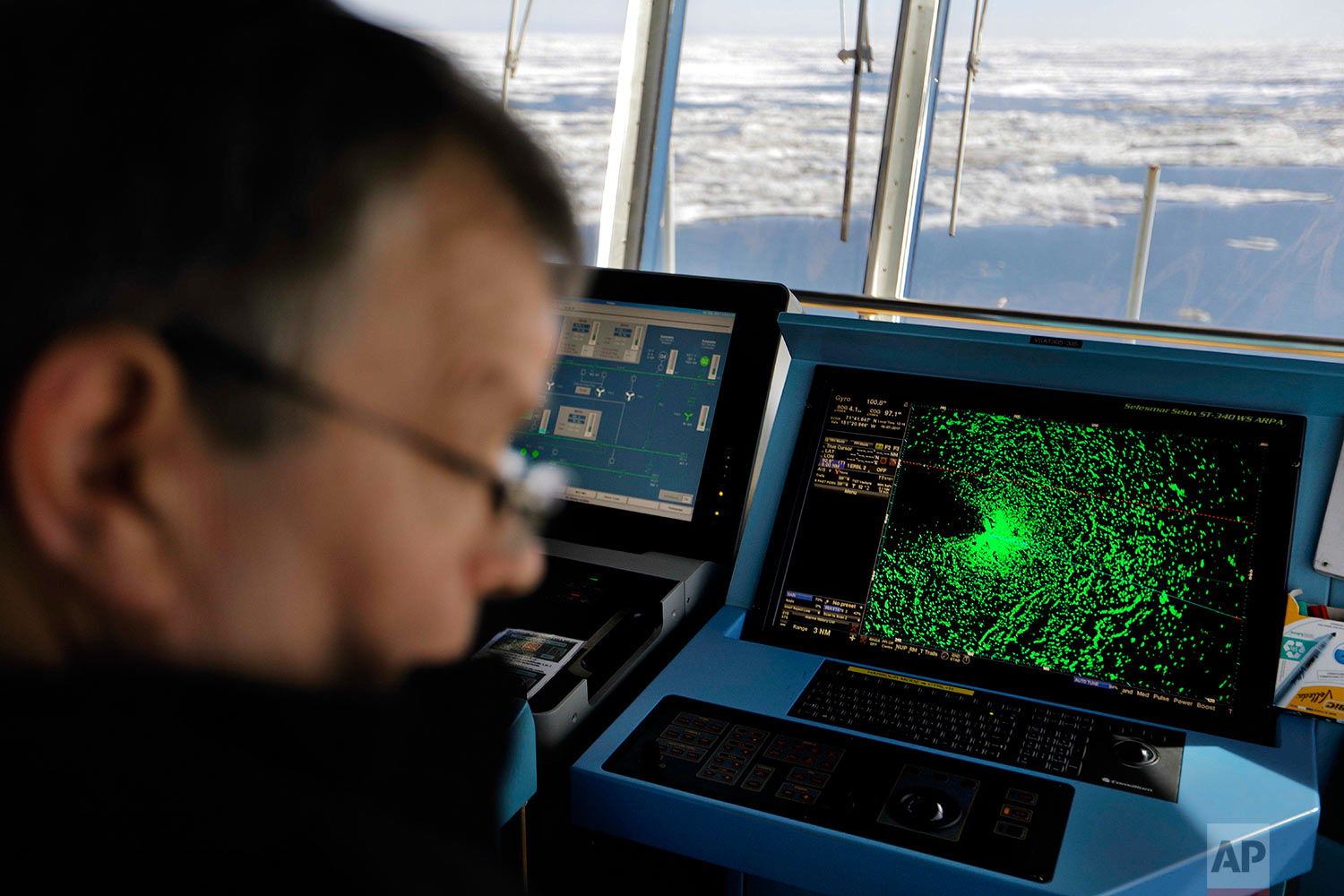 A radar shows sea ice ahead of the Finnish icebreaker MSV Nordica as chief officer Harri Venalainen navigates the ship through the Beaufort Sea while traversing the Arctic's Northwest Passage, Sunday, July 16, 2017. While icebreakers are equipped with sensitive radar systems, ultimately it's up to the ability and experience of the person at the helm to ensure the ship only breaks ice when it's unavoidable. (AP Photo/David Goldman)