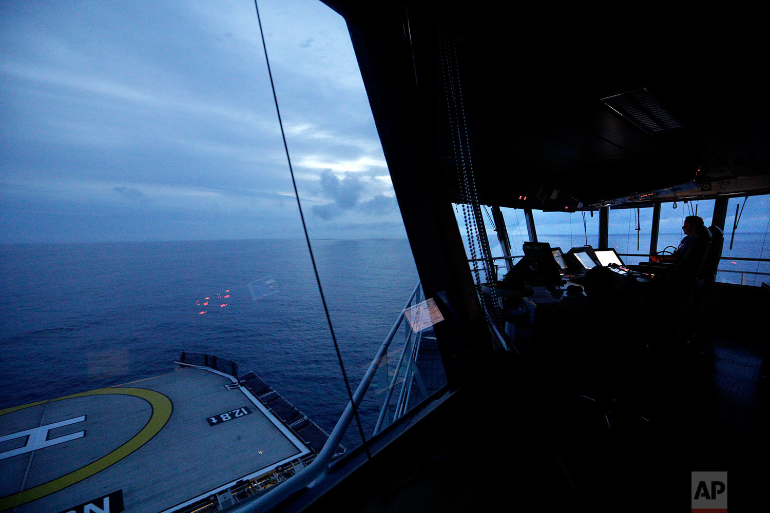 First officer Jukka Alhoke sits at the controls of the Finnish icebreaker MSV Nordica as it sets sail off the coast of Canada toward the Bering Strait, Thursday, July 6, 2017. The MSV Nordica is setting course to traverse the Northwest Passage, a route once considered impassible, from the Pacific ocean to the Atlantic via the Arctic. The icebreaker, which is returning to its home port of Helsinki, is carrying researchers studying the impact of the Arctic's melting sea ice on the fragile social and ecological balance in the region, and observers from the U.S. and Canadian Coast Guards. (AP Photo/David Goldman)