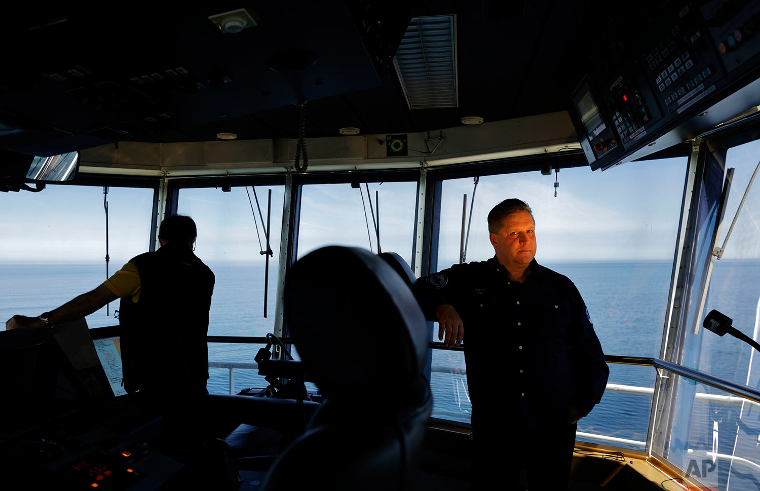 """Master Mariner Jyri Viljanen, 56, captain of the Finnish icebreaker MSV Nordica stands for a portrait in the ship's bridge as it sails north in the Bering Sea toward the Arctic, Thursday, July 13, 2017.  Viljanen has been going to sea for 39 years and this will be his first transit through the Arctic's Northwest Passage. """"It's once a lifetime,"""" said Viljanen. """"The biggest risk is these are very remote areas so if anything happens it's very difficult to get any help or rescue or anything."""" (AP Photo/David Goldman)"""