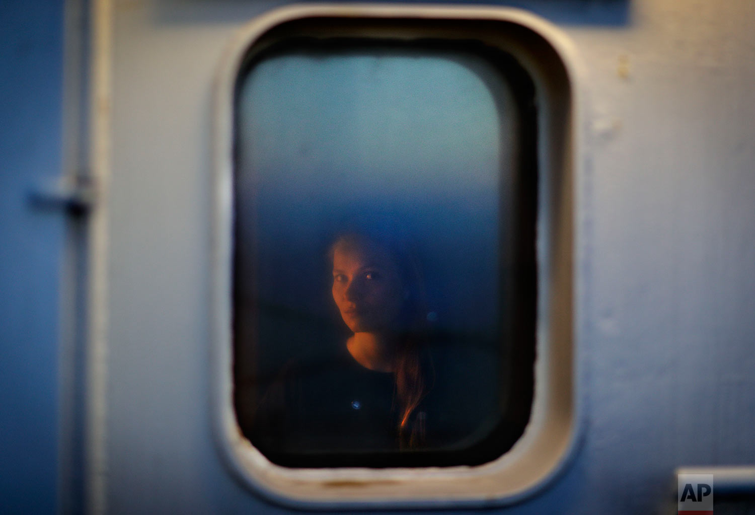 "Researcher Daria Gritsenko, 30, of the University of Helsinki, sits for a portrait in her cabin aboard the Finnish icebreaker MSV Nordica as the ship sails north in the Bering Sea toward the Arctic, Thursday, July 13, 2017. She is hoping to learn more about the Northwest Passage to aid her work in energy development in the Arctic. Although this will be her first transit through the passage, she has been to Svalbard, a Norwegian archipelago in the Arctic. ""I love the Arctic. It's such a powerful nature that I felt so little in comparison,"" she said. ""It makes you realize how much of dust you are on this planet. It's very intimidating but I felt very calm inside."" (AP Photo/David Goldman)"