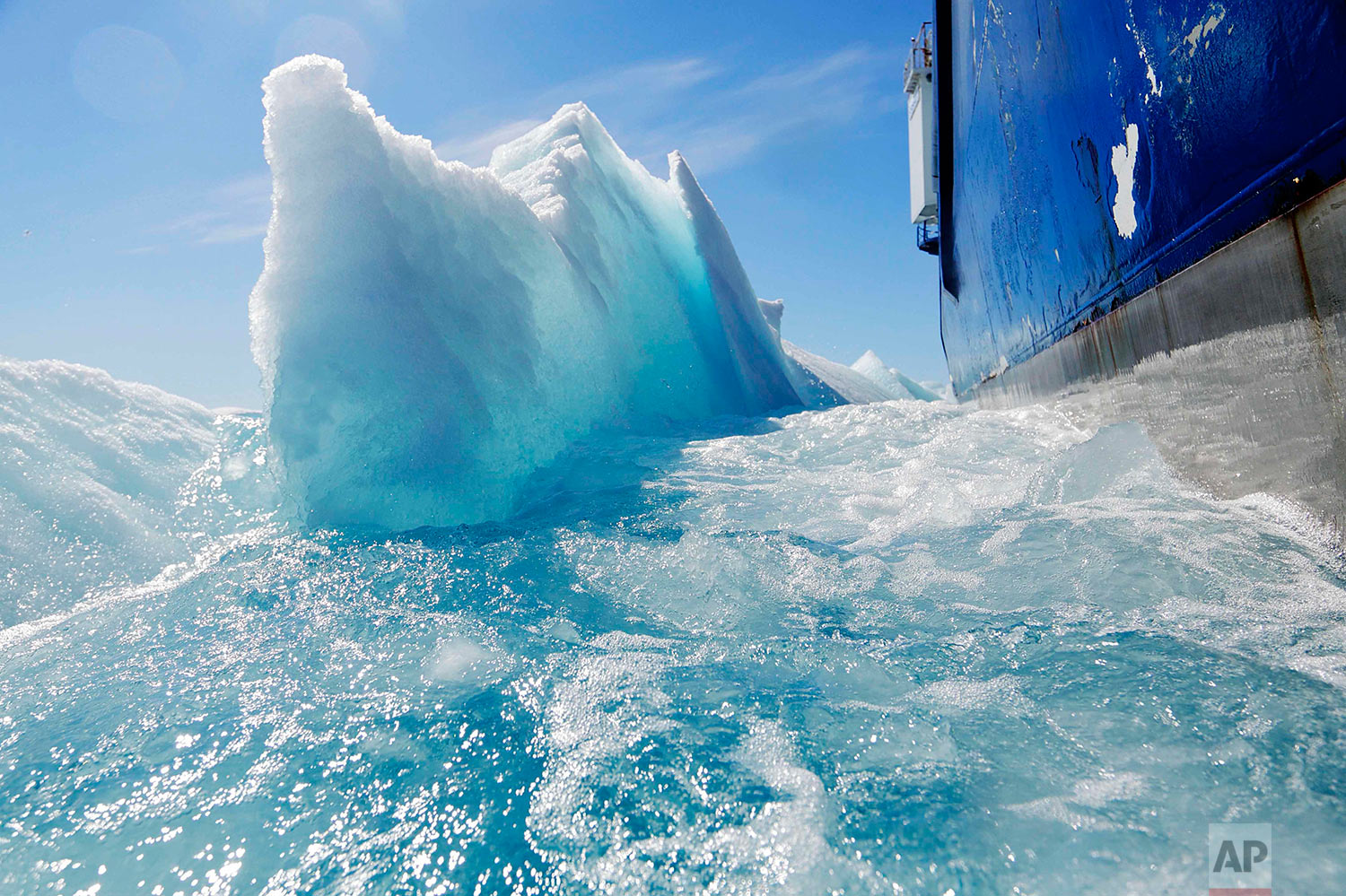 Broken sea ice emerges from under the hull of the Finnish icebreaker MSV Nordica as it sails through the Victoria Strait while traversing the Arctic's Northwest Passage, Friday, July 21, 2017. (AP Photo/David Goldman)