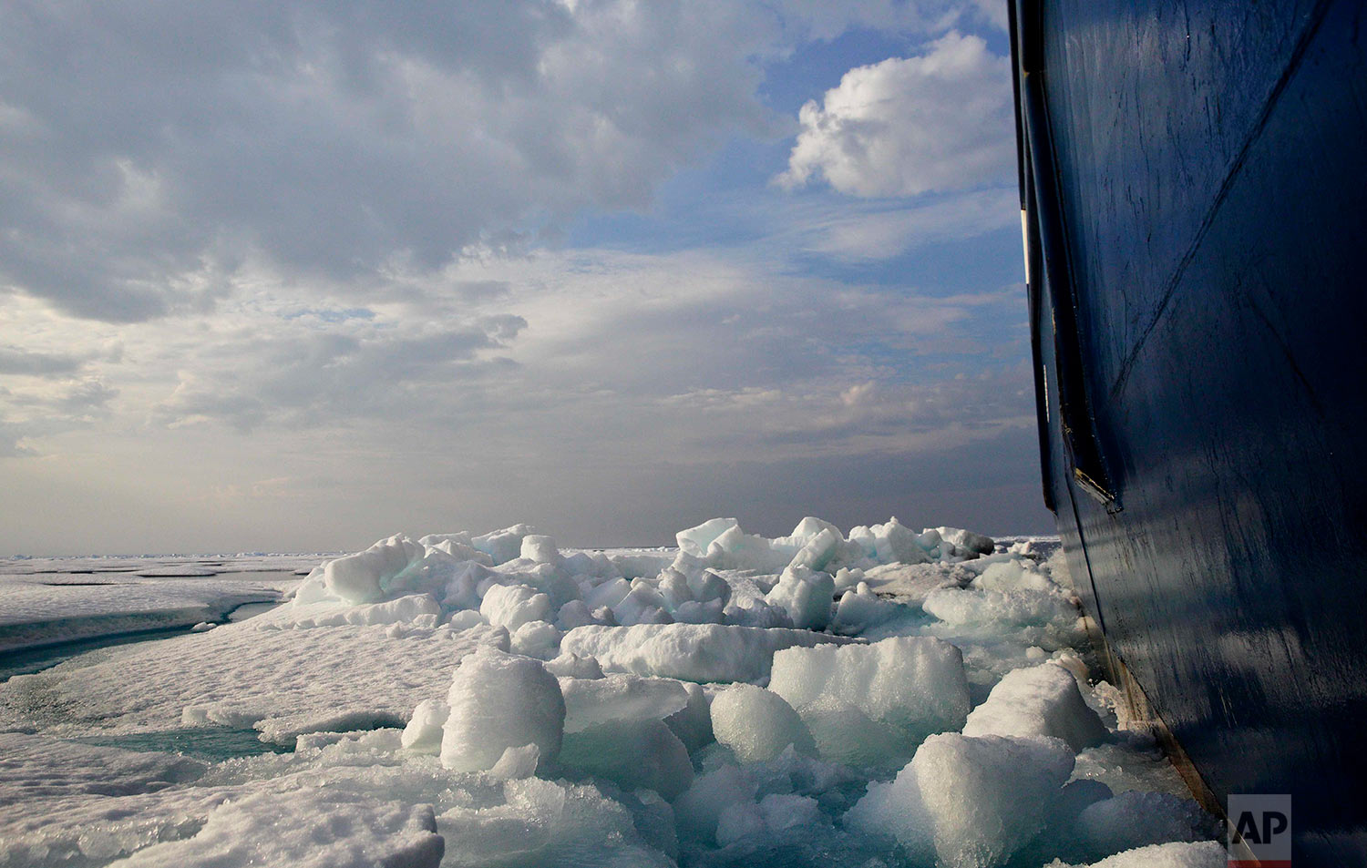 Broken sea ice is pushed aside as the Finnish icebreaker MSV Nordica sails through the Franklin Strait while traversing the Arctic's Northwest Passage, Saturday, July 22, 2017. Sea ice forms when the top layer of water reaches freezing point, usually around the start of October. As temperatures continue to fall this first-year ice grows downward until it is several feet thick. If the ice survives the following summer melt it becomes second-year ice. Another cycle and it becomes multi-year ice, which is the toughest kind. (AP Photo/David Goldman)