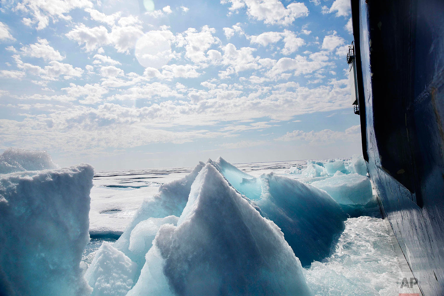 Broken sea ice emerges from under the hull of the Finnish icebreaker MSV Nordica as it sails through the Franklin Strait while traversing the Arctic's Northwest Passage, Saturday, July 22, 2017. Sea ice forms when the top layer of water reaches freezing point, usually around the start of October. As temperatures continue to fall this first-year ice grows downward until it is several feet thick. If the ice survives the following summer melt it becomes second-year ice. Another cycle and it becomes multi-year ice, which is the toughest kind. (AP Photo/David Goldman)