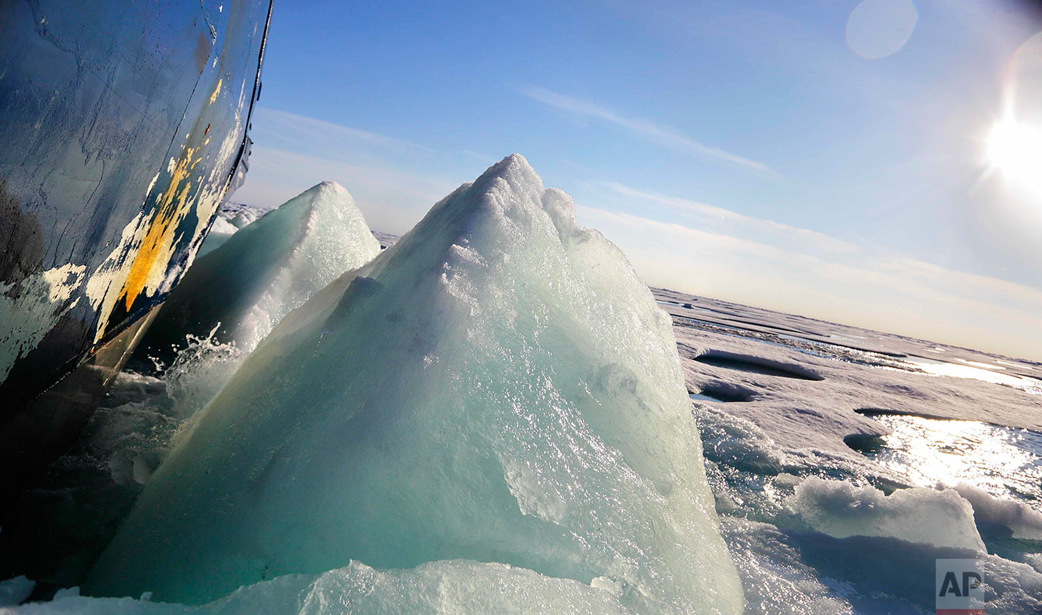 Broken sea ice emerges from under the hull of the Finnish icebreaker MSV Nordica as it sails through the Victoria Strait while traversing the Arctic's Northwest Passage, Friday, July 21, 2017. Sea ice forms when the top layer of water reaches freezing point, usually around the start of October. As temperatures continue to fall this first-year ice grows downward until it is several feet thick. If the ice survives the following summer melt it becomes second-year ice. Another cycle and it becomes multi-year ice, which is the toughest kind. (AP Photo/David Goldman)