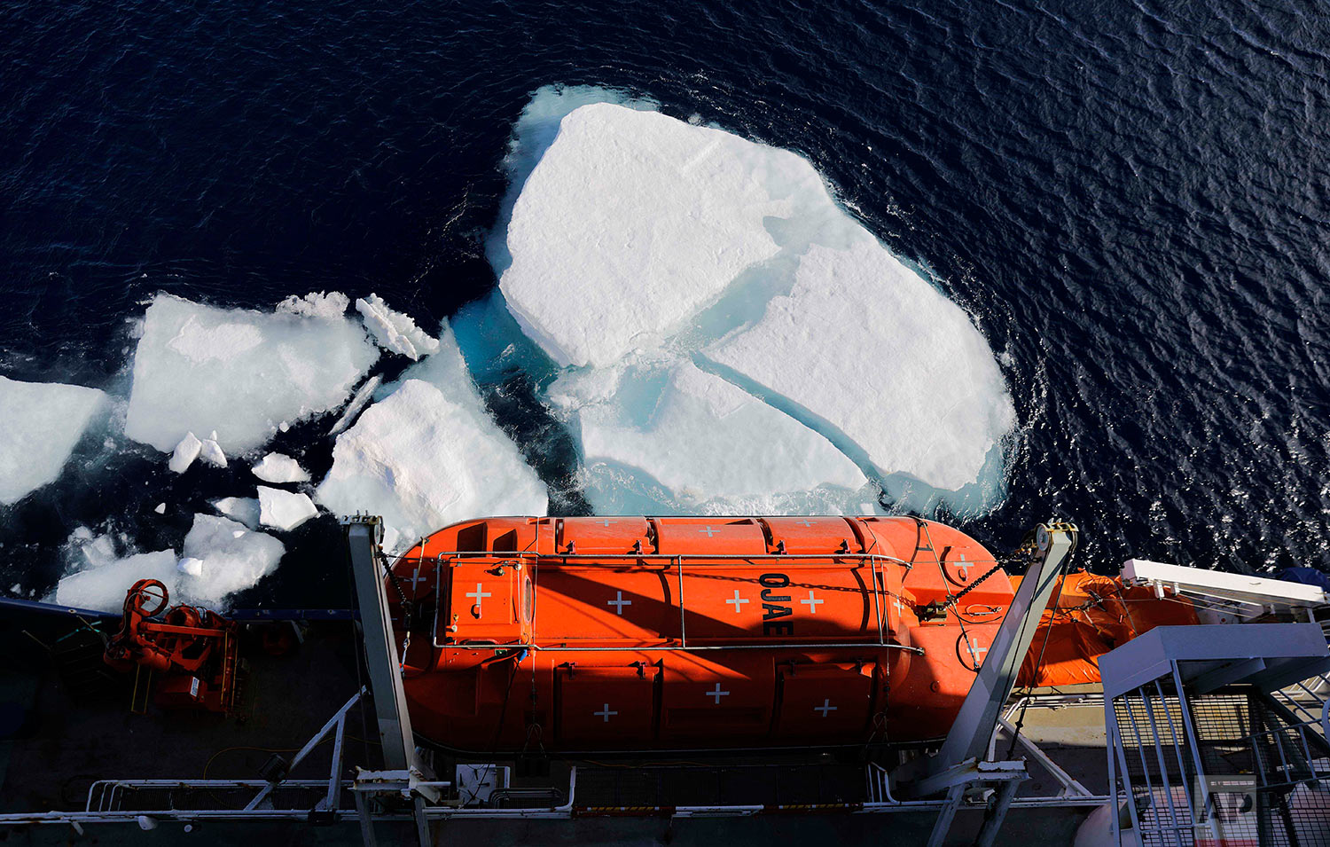 Sea ice breaks apart as the Finnish icebreaker MSV Nordica equipped with enclosed life boats sails the Chukchi Sea to traverse the Arctic's Northwest Passage, Sunday, July 16, 2017. (AP Photo/David Goldman)