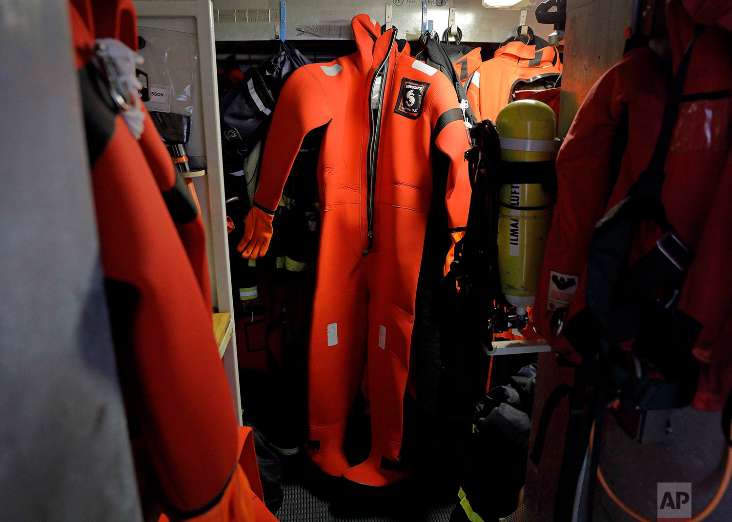 A survival suit is displayed aboard the Finnish icebreaker MSV Nordica as it sails through Lancaster Sound while traversing the Northwest Passage through the Canadian Arctic Archipelago, Monday, July 24, 2017. (AP Photo/David Goldman)