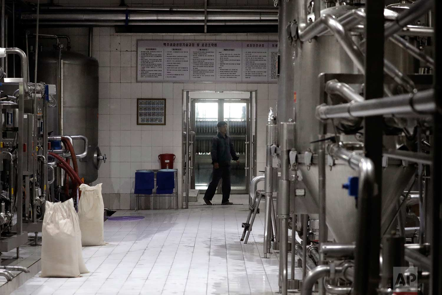 In this Wednesday, July 26, 2017, photo, a worker monitors machinery used to brew beer at the Taedonggang Brewery in Pyongyang, North Korea.  (AP Photo/Wong Maye-E)