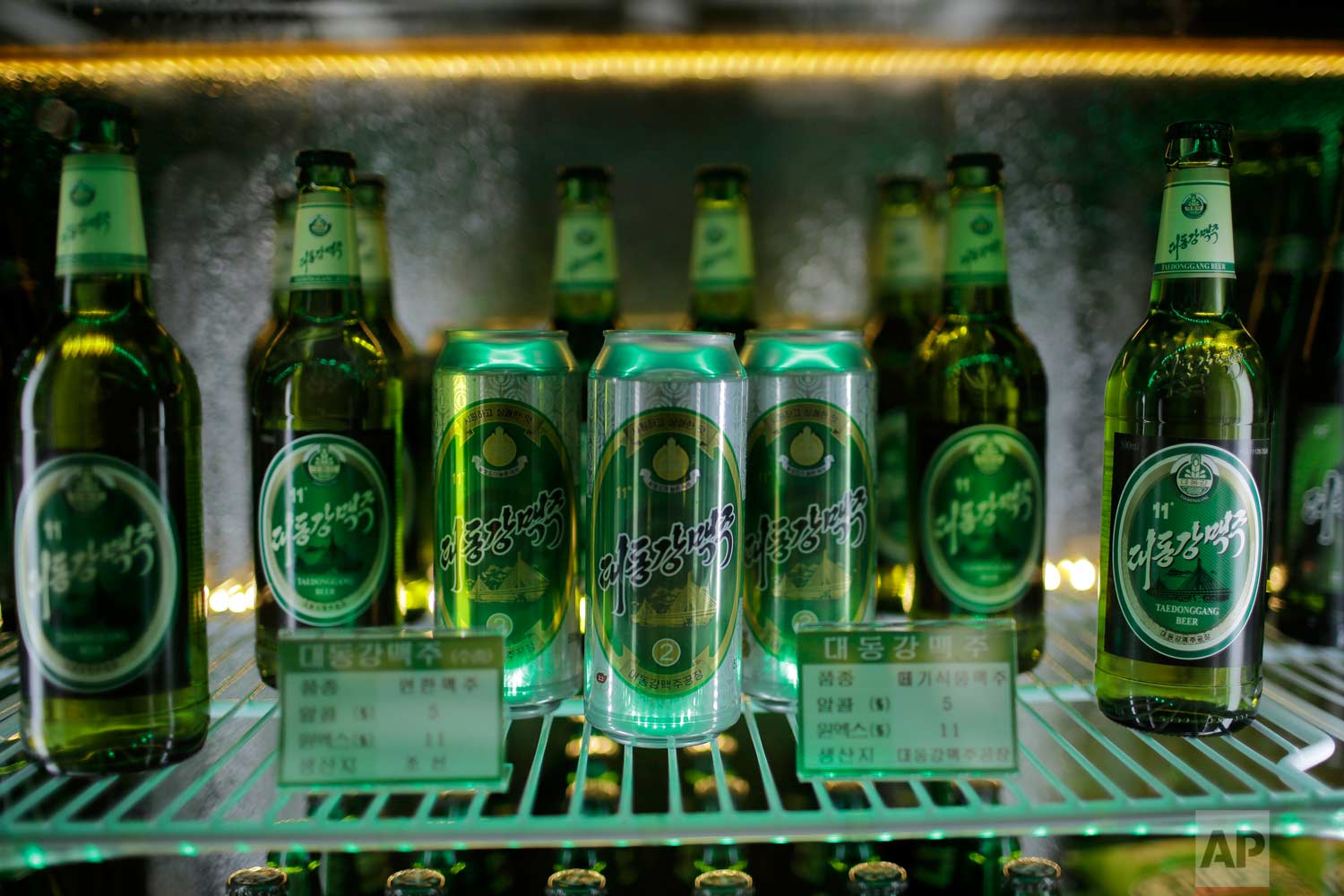 In this Wednesday, July 26, 2017, photo, samples of different types of Taedonggang beer are displayed in a refrigerator at the Taedonggang Brewery in Pyongyang, North Korea.  (AP Photo/Wong Maye-E)