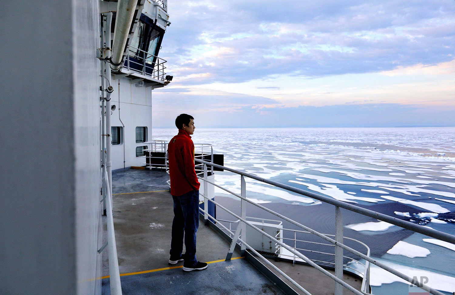 Trainee David Kullualik looks over the sea ice of Peel Sound. (AP Photo/David Goldman)