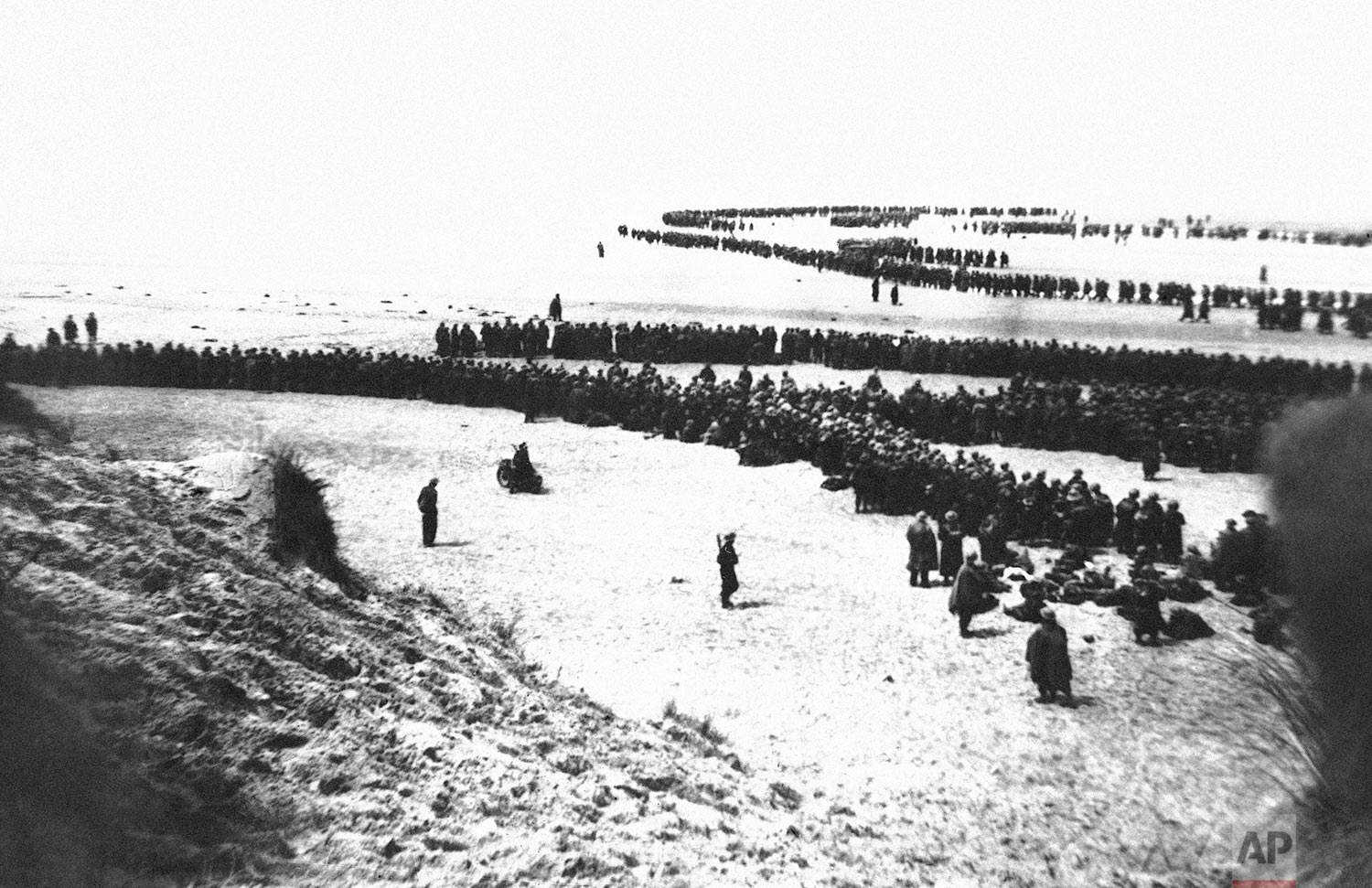 Thousands of British and French troops massed on the beach of Channel port in Dunkirk, France on June 4, 1940 awaiting ships to return them to England. (AP Photo)