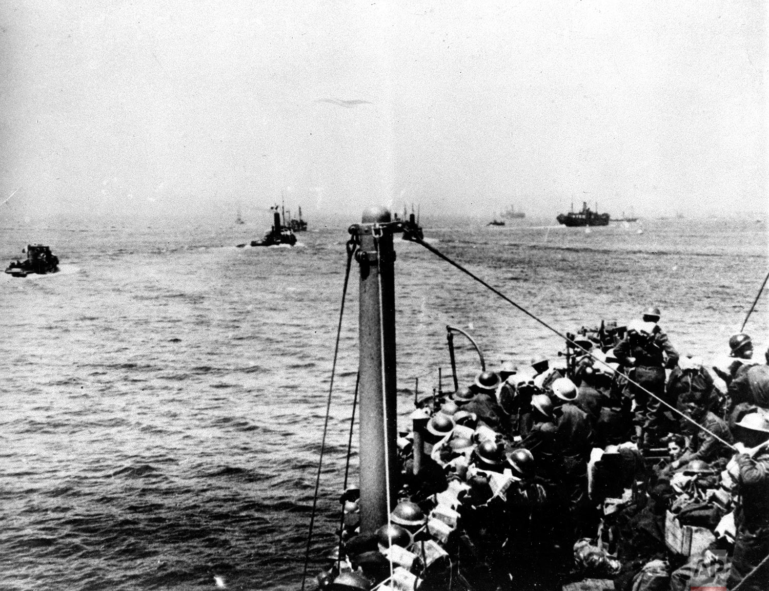 Some of the many ships carrying Allied forces across the English Channel from Dunkirk, France, between May 29 and June 3, 1940, are shown en route for England during the successful Operation Dynamo in World War II.  Over three-hundred thousand French, British and Belgian troops escaped the German invasion from the beaches near Dunkirk.  (AP Photo)