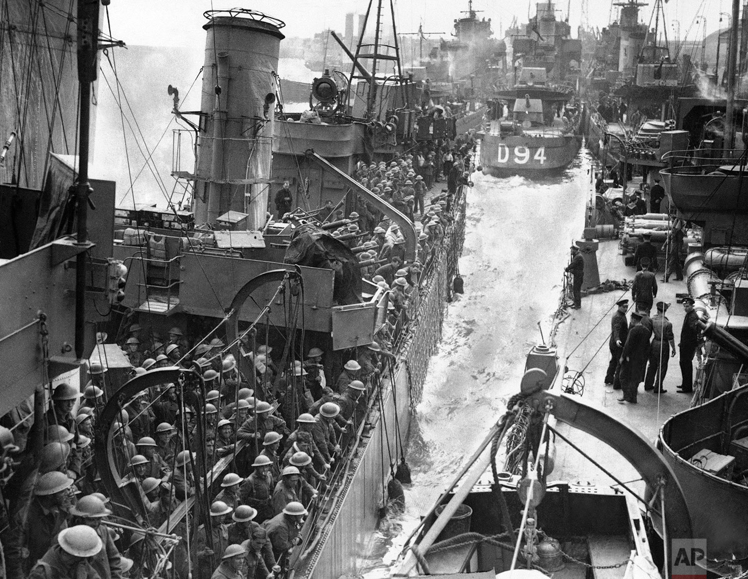 Men of the B.E.F. safely home after their gallant fight in Flanders seen on transport ships at the Quayside on June 6, 1940. Many sorts and sizes of vessels taking part in the grand evacuation from Dunkirk. (AP Photo)
