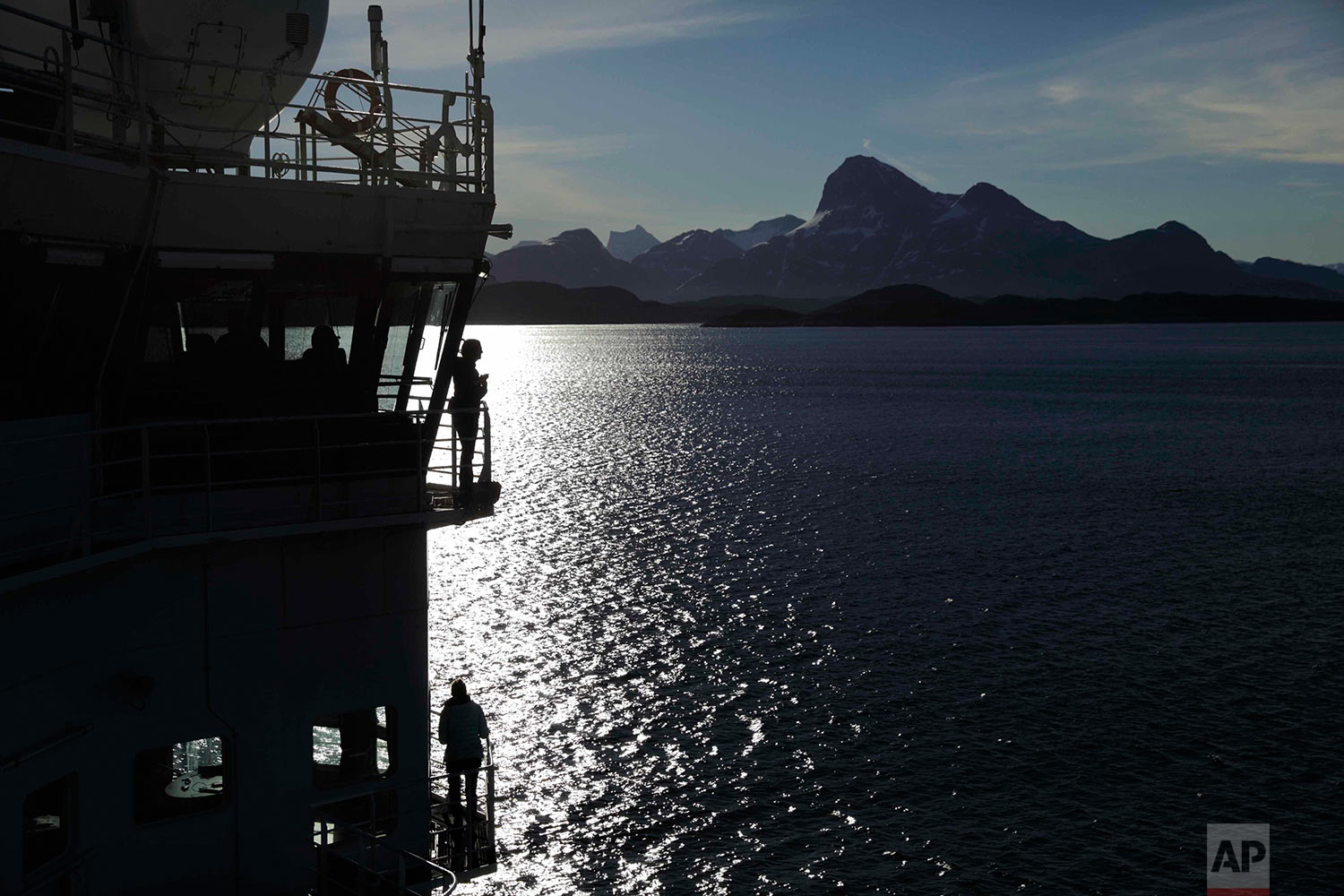 Personnel stand aboard the Finnish icebreaker MSV Nordica as it arrives into Nuuk, Greenland, after traversing the Northwest Passage through the Canadian Arctic Archipelago, Saturday, July 29, 2017. After 24 days at sea and a journey spanning more than 10,000 kilometers (6,214 miles), the MSV Nordica has set a new record for the earliest transit of the fabled Northwest Passage. The once-forbidding route through the Arctic, linking the Pacific and the Atlantic oceans, has been opening up sooner and for a longer period each summer due to climate change. (AP Photo/David Goldman)