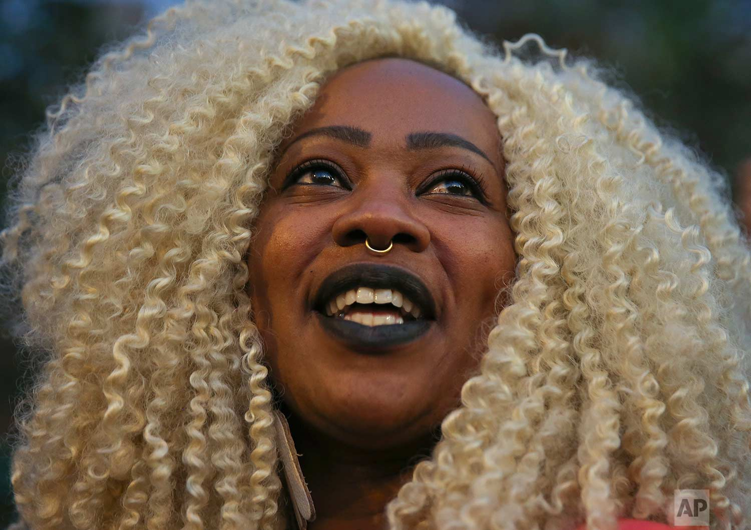 Isabel Nunes, who works as a beautician, attends a women's march to mark the International Afro-Latin American and Afro-Caribbean Women's Day, and protest against racist and sexist oppression, in Sao Paulo, Brazil, Tuesday, July 25, 2017. (AP Photo/Andre Penner)