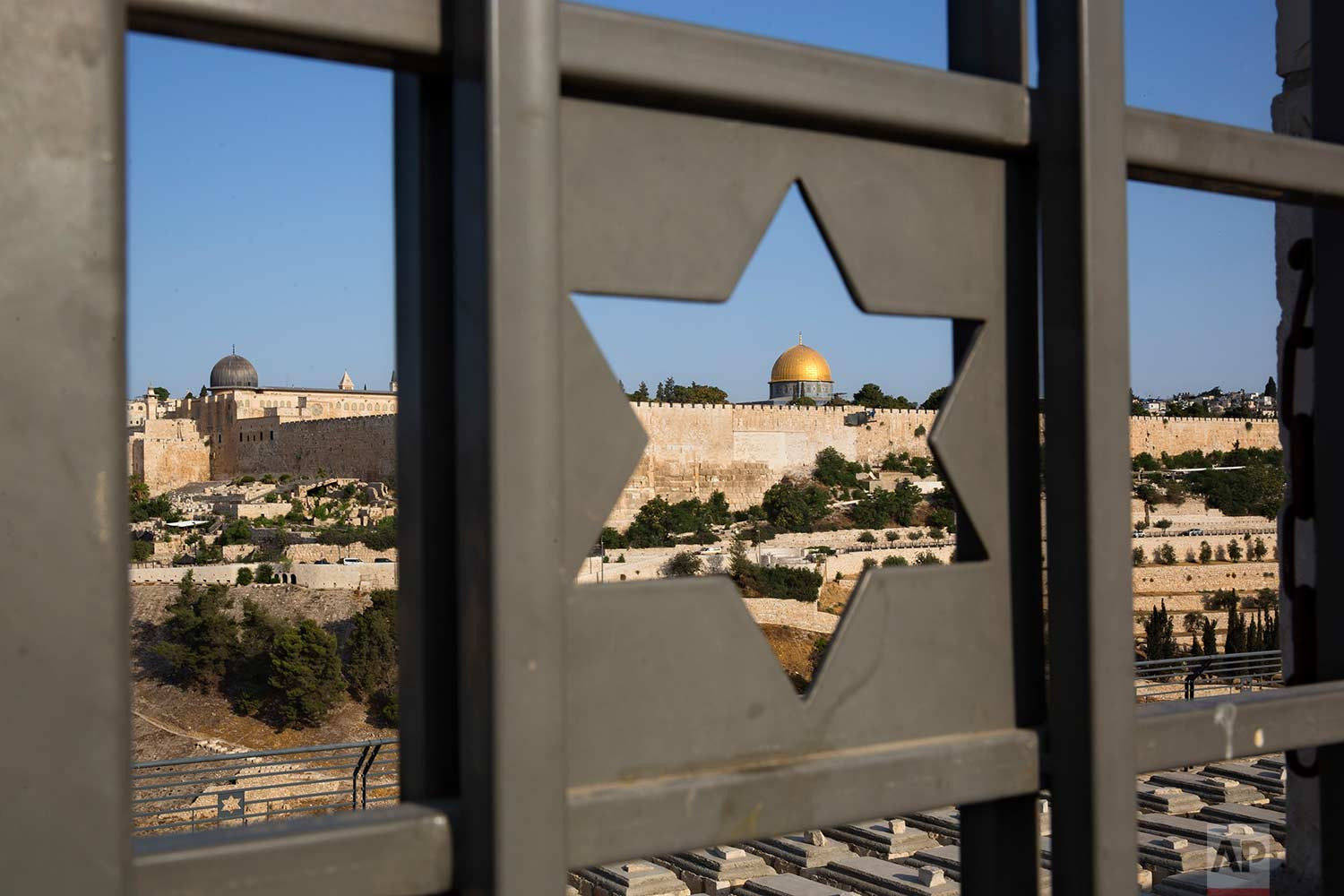 The Islamic Dome of the Rock in Jerusalem's Old City is seen trough a door decorated with a Jewish Star of David, Tuesday, July 25, 2017. (AP Photo/Oded Balilty)