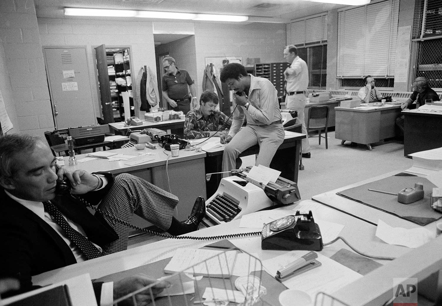 "New York City police are seen at work on the ""Son of Sam"" serial killer case at Police Headquarters in New York, July 19, 1977.  (AP Photo/Richard Drew)"
