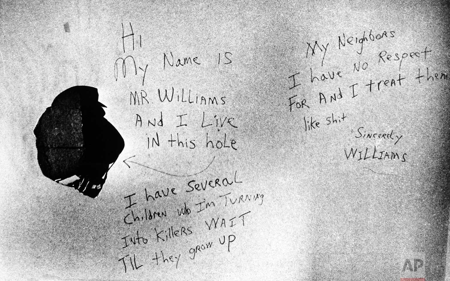 "These handwritten messages were found on the wall in the apartment of .44-caliber ""Son of Sam"" shooting suspect David Berkowitz in Yonkers, New York, Thursday, Aug. 12, 1977. The suspect is undergoing psychiatric questioning on Friday to determine if he is fit to stand trial. (AP Photo)"