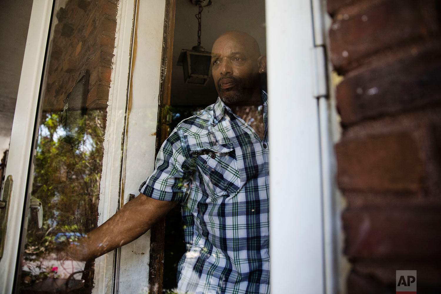 Earl Rice Jr. steps from his boyhood home in Wilmington, Del., Thursday, May 18, 2017. (AP Photo/Matt Rourke)