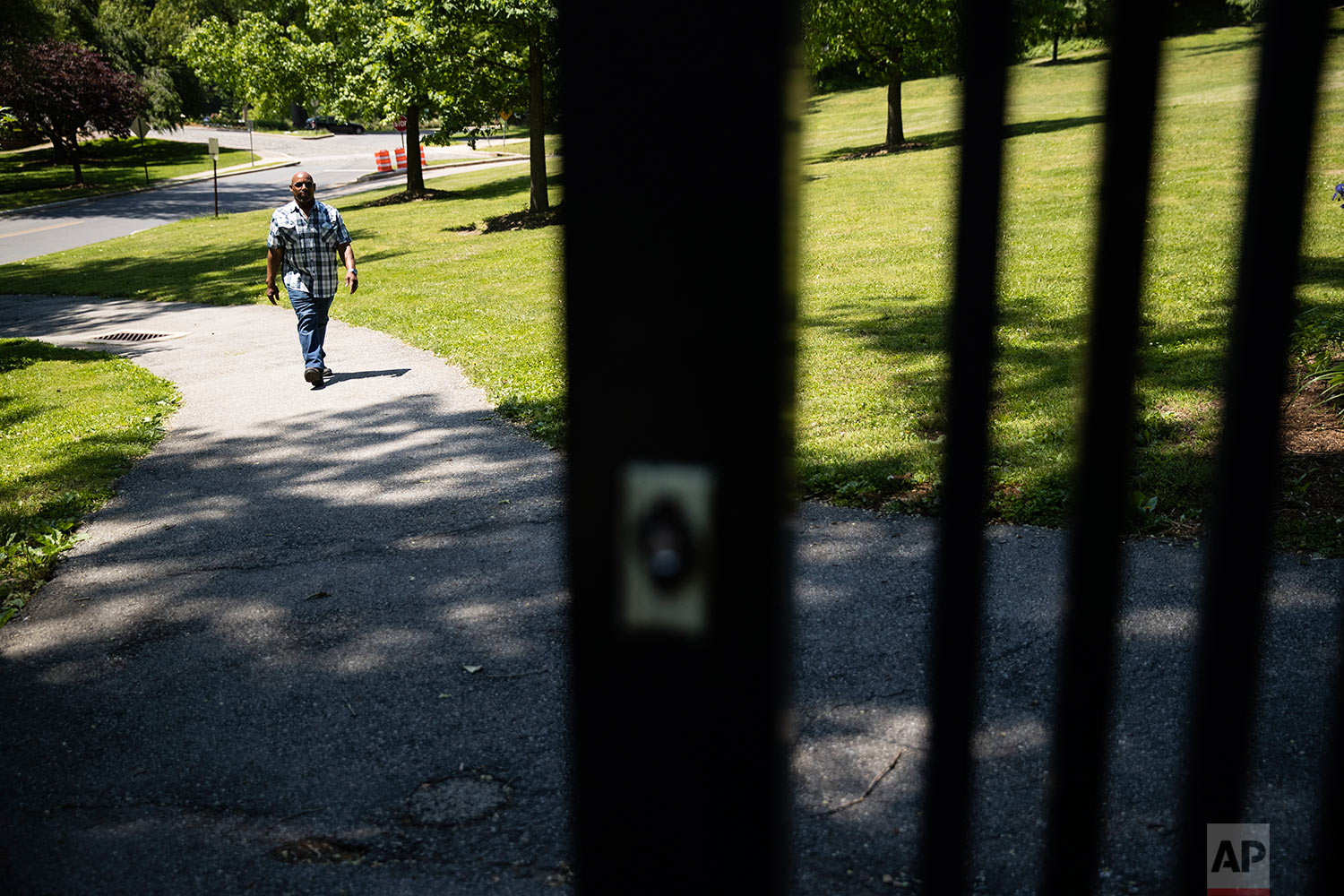 Earl Rice Jr. walks in the park near his home in Wilmington, Del., Thursday, May 18, 2017. In September 1973, Rice and his friend ran toward Ola Danenberg, and Rice snatched her purse. As he took off down an alley, he says he looked back to see Danenberg fall to her knees. Two days later, hearing police were looking for him, Rice went to the police station and confessed to robbery. That's when detectives told him Danenberg had hit her head on the sidewalk and died. They charged him with murder. (AP Photo/Matt Rourke)