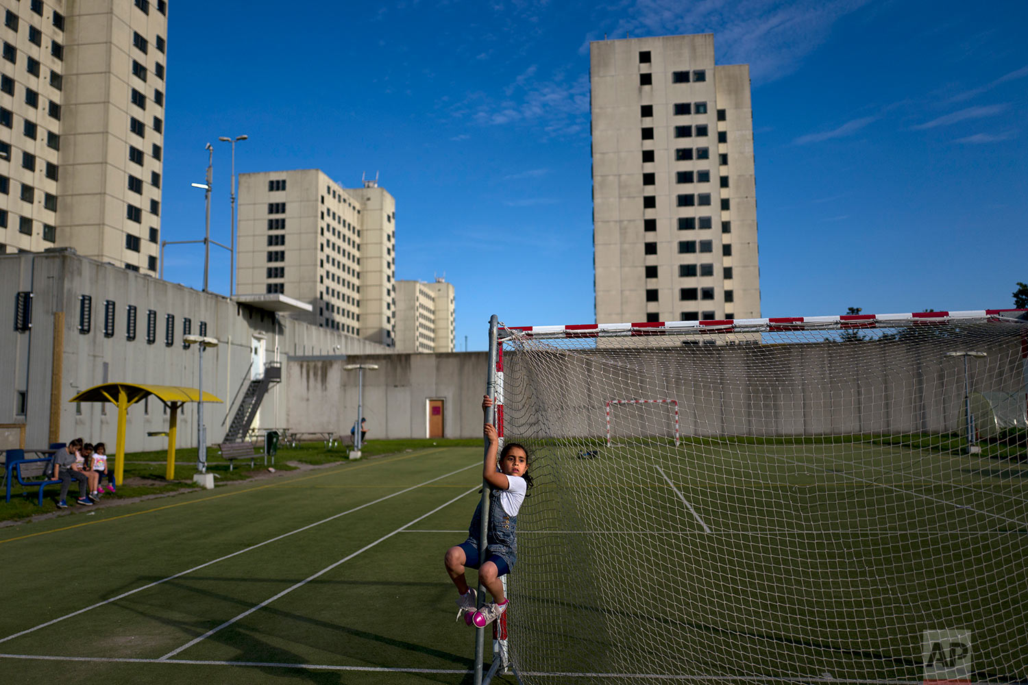 In this Tuesday, July 18, 2017 photo, refugee Amal Sakkal, 8, from Damascus, Syria, plays at the former prison of Bijlmerbajes in Amsterdam, Netherlands. (AP Photo/Muhammed Muheisen)