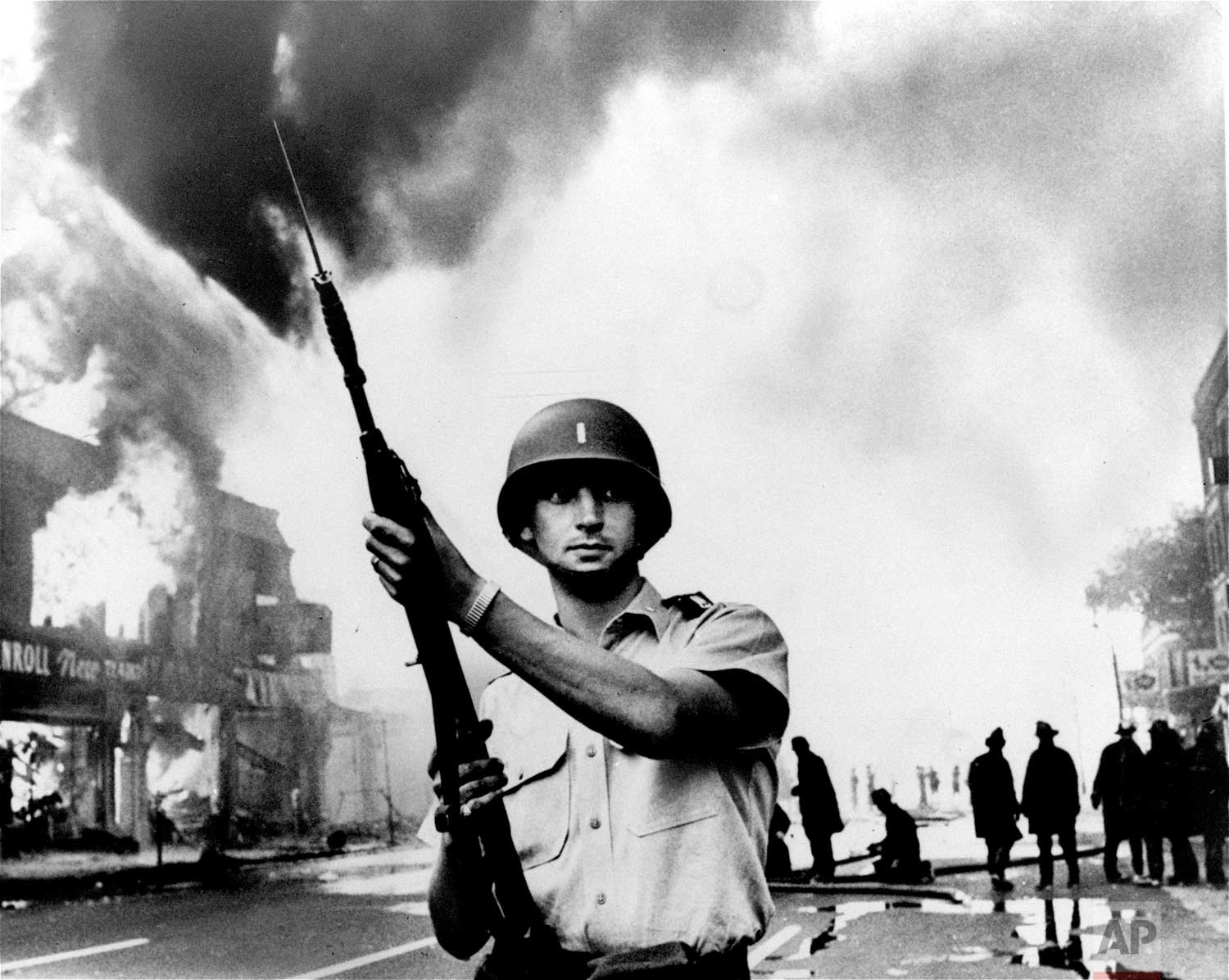 In this July 1967 photo, a National Guardsman stands at a Detroit intersection during riots in the city. Detroit wasn't the first of the riots in the summer of 1967, and it was far from the last. Buffalo, New York, and Newark, New Jersey, preceded it; in the course of the summer, more than 150 cases of civil unrest erupted across the United States. (AP Photo)
