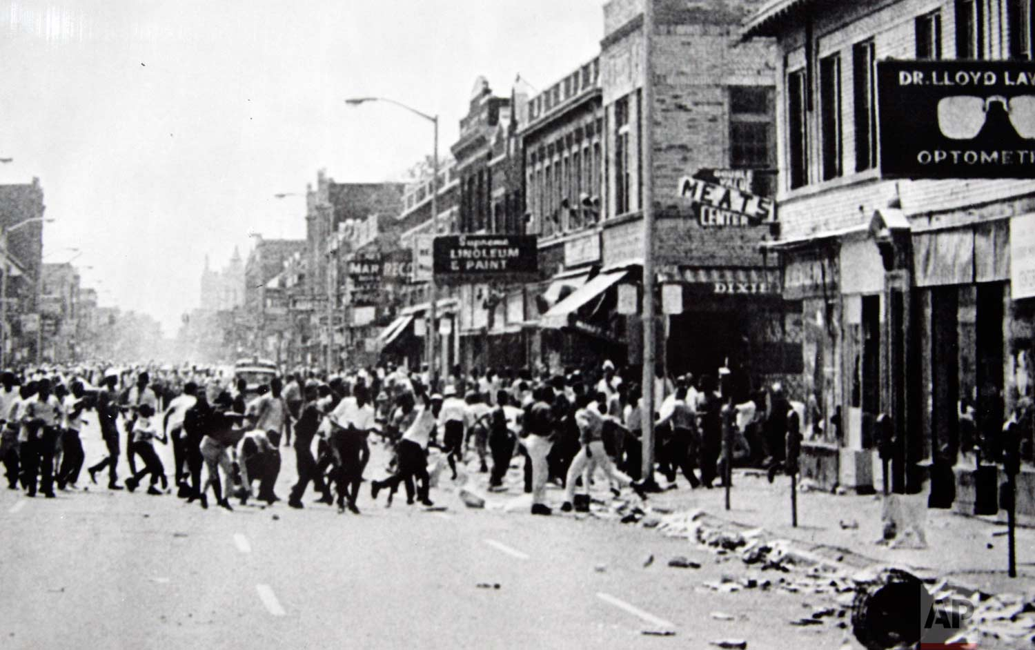 In this July 23, 1967 photo, hundreds of people run down 12th Street on Detroit's westside throwing stones and bottles at storefronts. The riot started after police raided an after-hours club in a predominantly African-American neighborhood. The raid, though, was just the spark. Many in the community blamed frustrations blacks felt toward the mostly white police, and city policies that pushed families into aging and over-crowded neighborhoods. (AP Photo)
