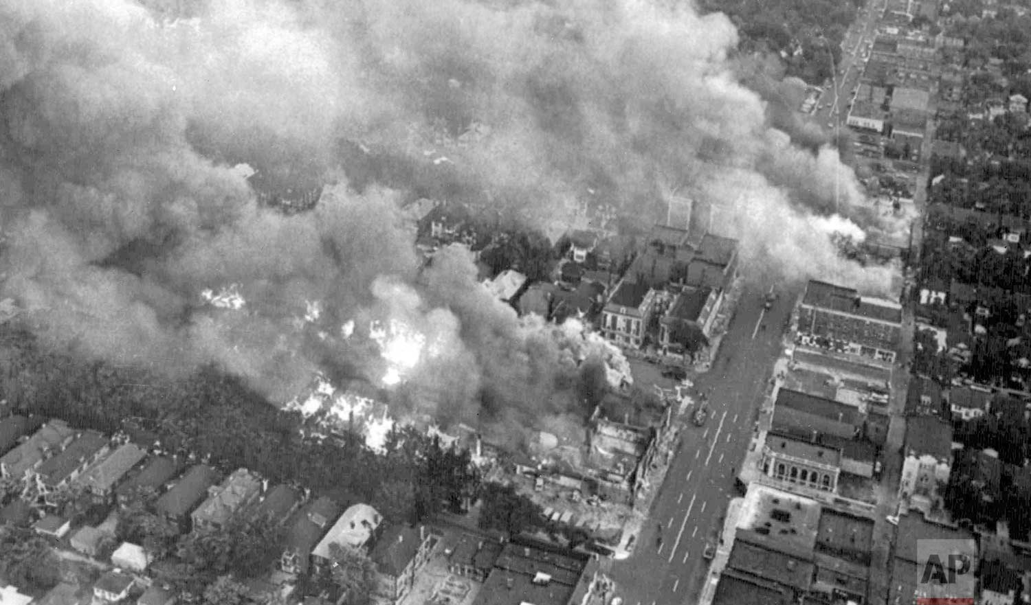 In this July 24, 1967 photo, multiple fires burn in a section of riot-torn Detroit, about three miles west of the downtown area. Five days of violence would leave 33 blacks and 10 whites dead, and more than 1,400 buildings burned. More than 7,000 people were arrested. (AP Photo)